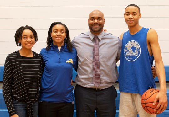 From left, Raina, Pam, Bobby and Bryce McGowens share a moment following practice at Wren High School.