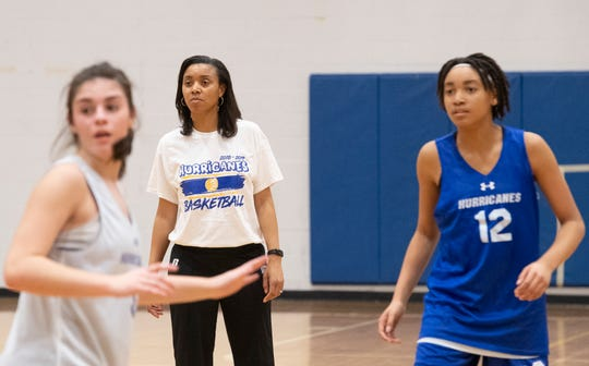 Pam McGowens watches her team practice at Wren High School Wednesday, Feb. 6, 2019. McGowens is the head coach of the girls team at Wren, which includes her daughter Raina (right).