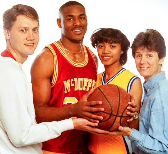 Bobby McGowens, middle left, of McDuffie High School in Anderson, and Pam Owens, middle right, of Wren High School in April 1993, pose with their coaches, Barney Brown, left, and Lynn Hicks for as Independent Mail All Area player and coach honors.