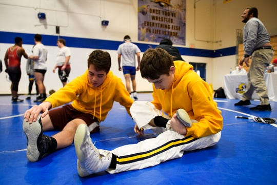 Roy Price and Taz Nelson of Eastside, stretching stretch before  the Region 2-AAAA wrestling championship, and Aden Leonard played key roles in leading the Eagles to the win in the Upper State championship on Thursday night.