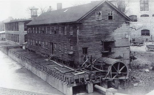 A wooden building in the 1800s that was once part of a wagon-making industrial complex along the Reedy River and is now the footprint of a proposed expansion of the Wyche Pavilion.