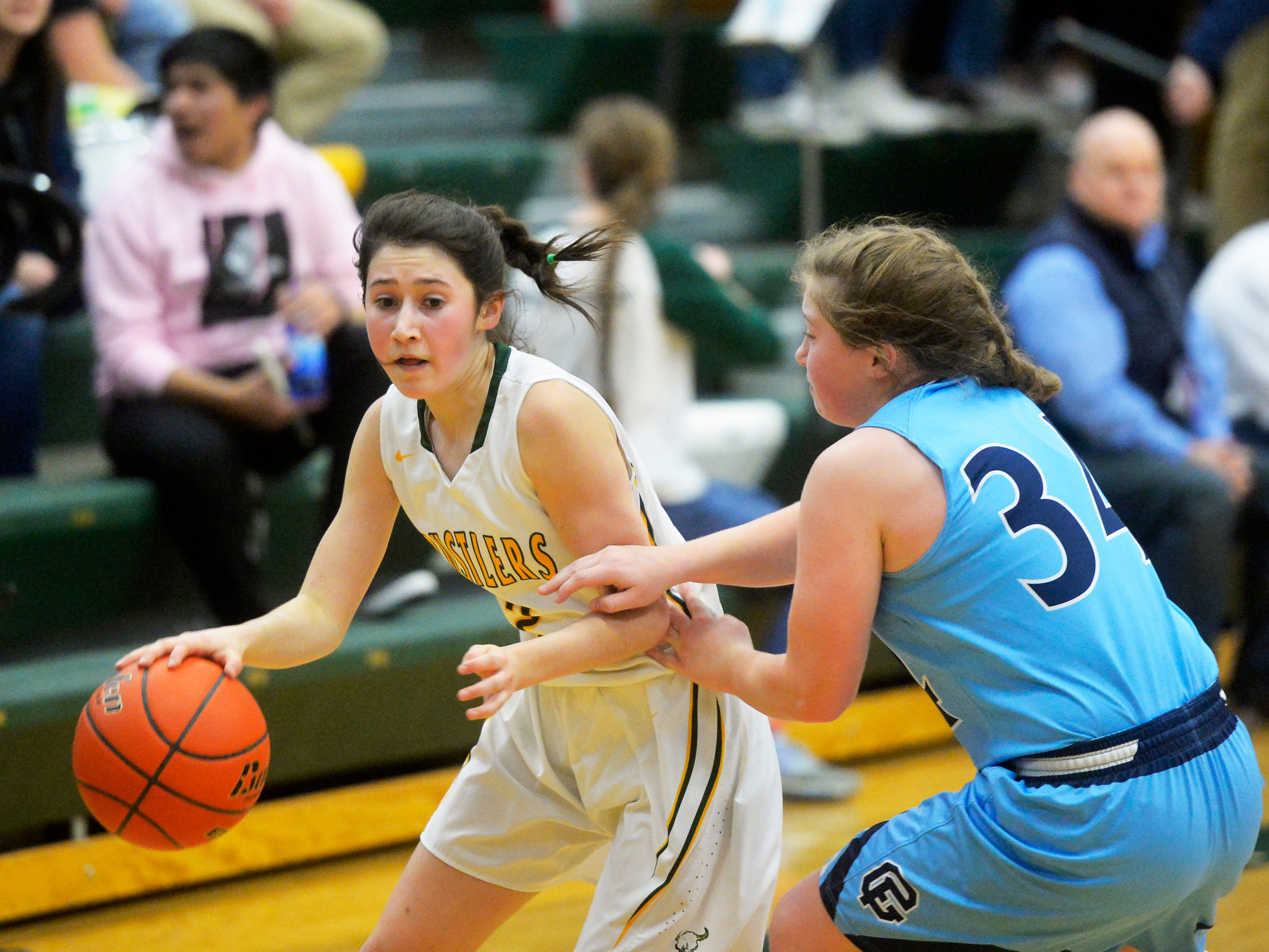 CMR's Lauren Lindseth attempts to dribble by Great Falls High's Ryen Palmer in the girls crosstown basketball game at the CMR Fieldhouse, Thursday night.