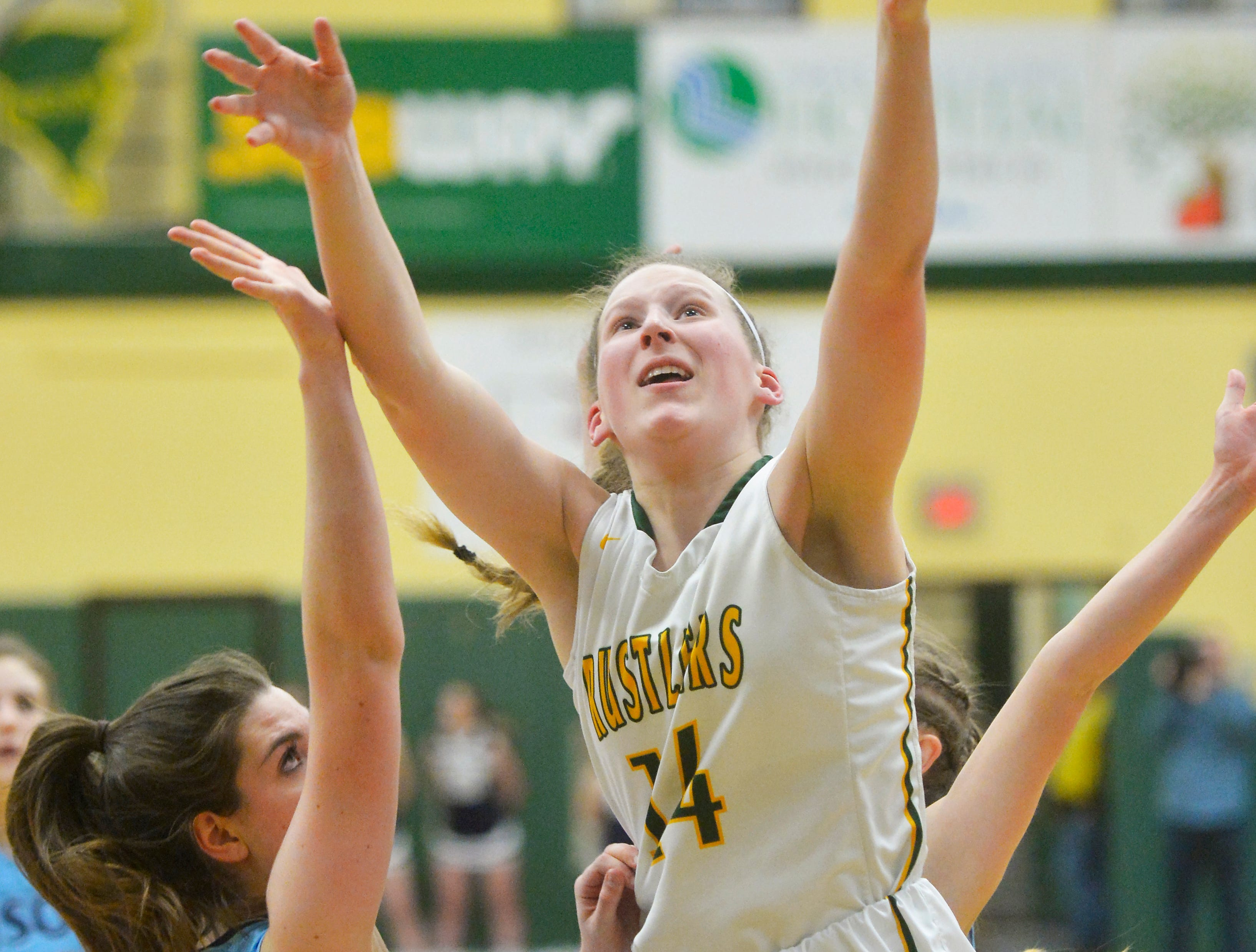 CMR's Allie Olsen attempts a shot over Great Falls High's Erin Watt during the girls crosstown basketball game in the CMR Fieldhouse, Thursday night.