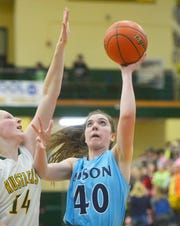 Great Falls High senior Erin Watt, who led all scorers with 13 points, goes up for two points in crosstown victory over C.M. Russell High and Rustler junior Allie Olsen.