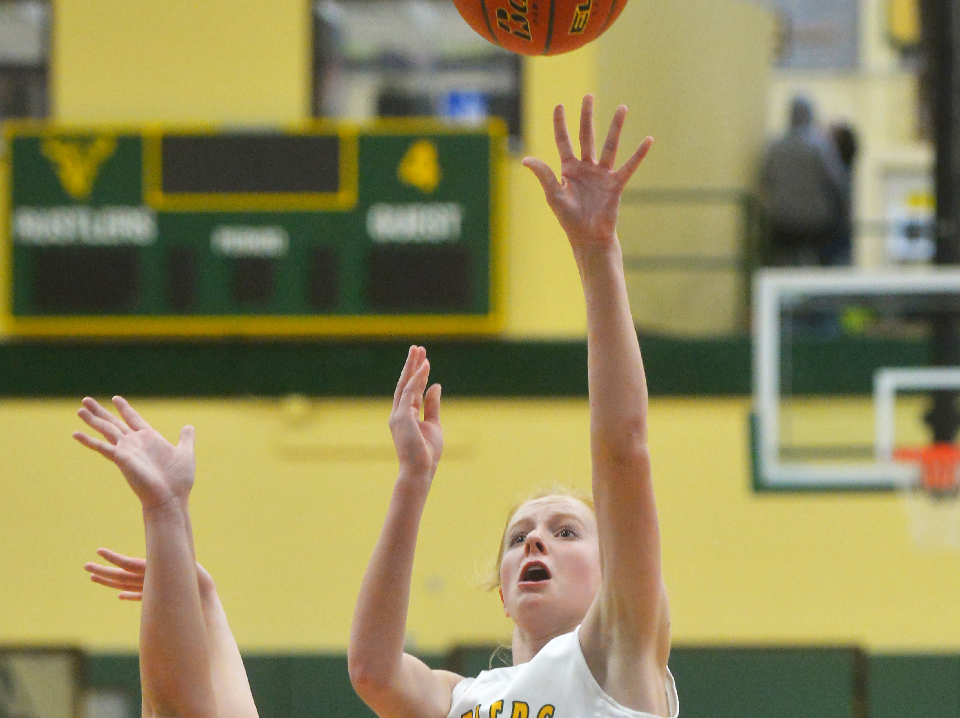 CMR's Emily Funseth shoots during the girls crosstown basketball game against Great Falls High in the CMR Fieldhouse, Thursday night.