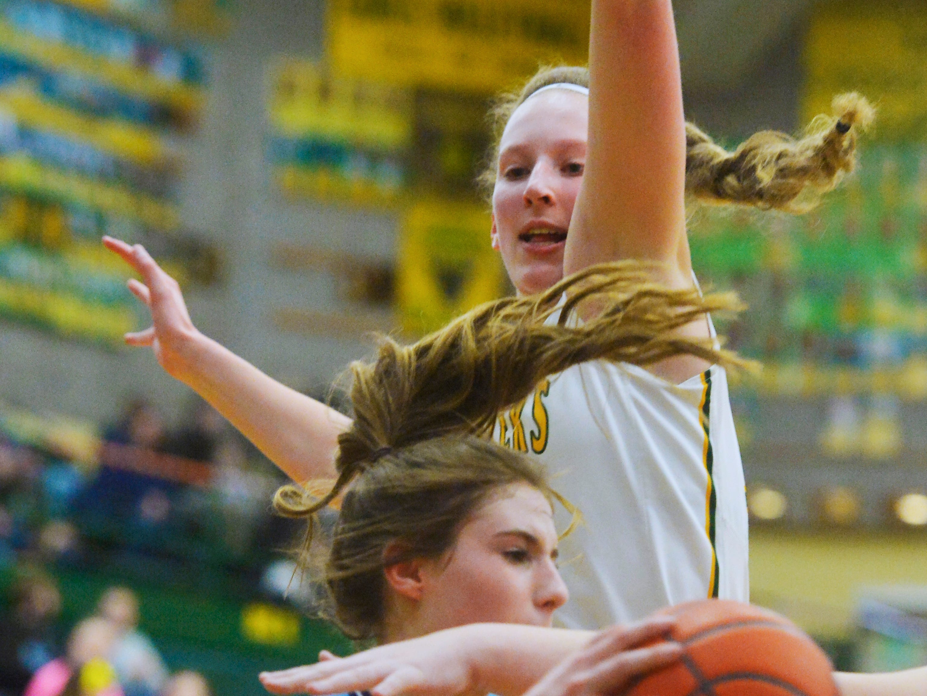 CMR's Allie Olsen defends along the baseline during the girls crosstown basketball game against Great Falls High in the CMR Fieldhouse, Thursday night.