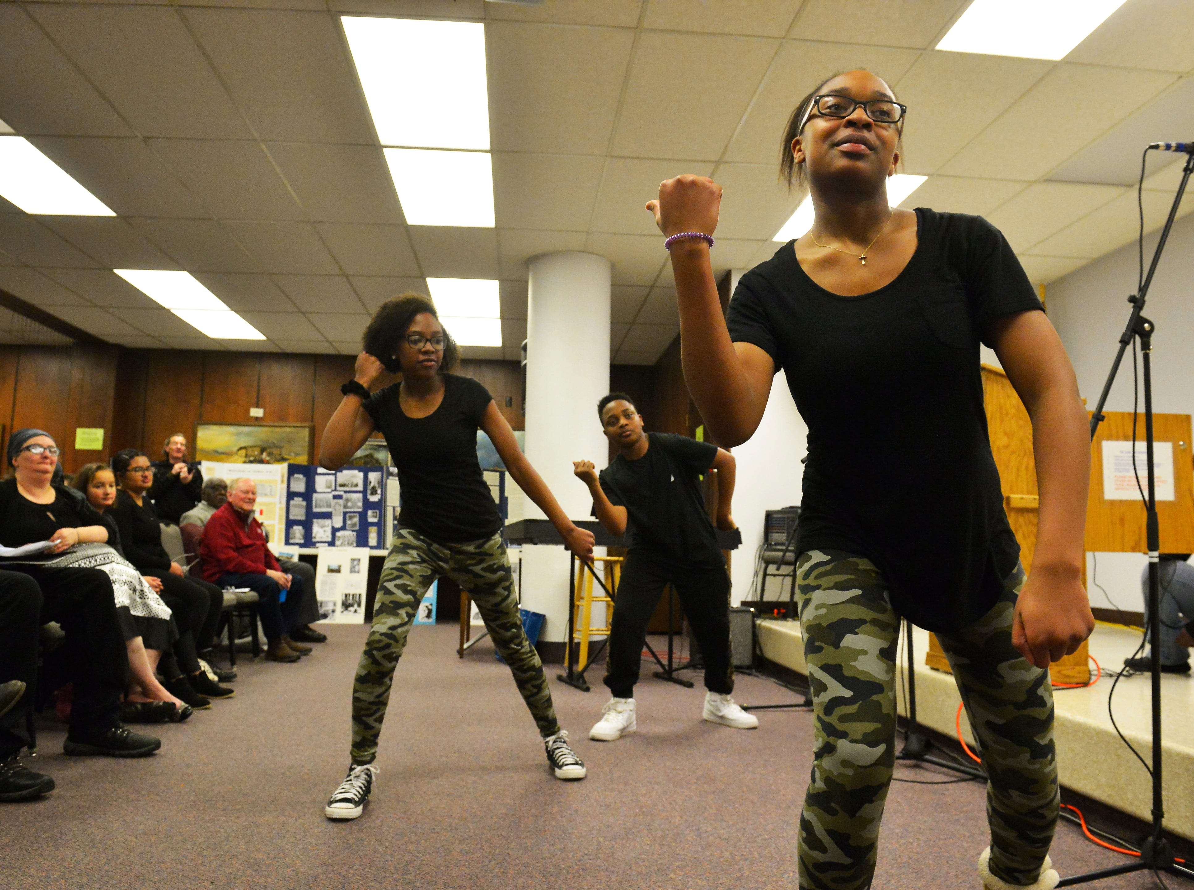 Members of the Alexander Temple Hip Hop Saints dance group, Sareya Hicks, front,  Maliyah Hicks, center, and Bryan Washington perform during Black Heritage Evening, an event presented by the Great Falls Public Library and the Alma Smith-Jacobs Foundation to celebrate the African-American community's heritage in Great Falls, Thursday evening at the Great Falls Public Library.