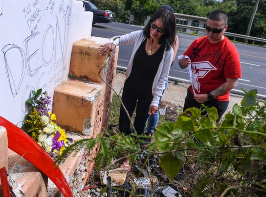 Barbara Quidachay, front, is overcome with emotion on Feb. 7, 2019, after placing a floral arrangement for her grandson, Deon Cruz, on a concrete sign he crashed into as a result of a two-car collision on Route 4 on the evening of Feb. 4. Accompanying Quidachay, are Cruz's aunts, Cali Duenas, right, and Cassie Duenas.