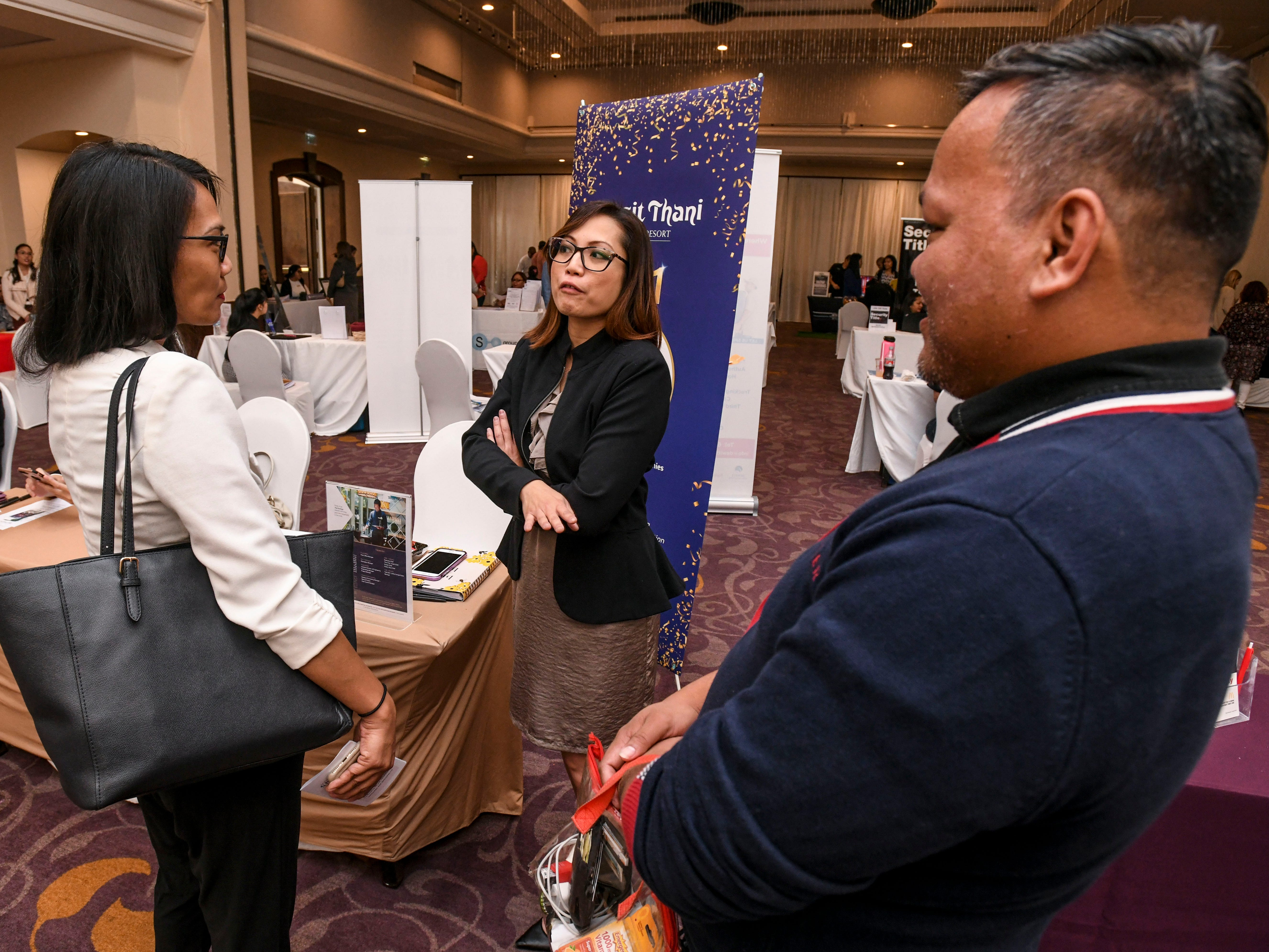 """Job seekers and prospective employers interact with one another during the Guam Chamber of Commerce's Women's Network 4th annual """"Propel Yourself"""" job fair at the Hyatt Regency Guam in Tumon on Friday, Feb. 8, 2019."""