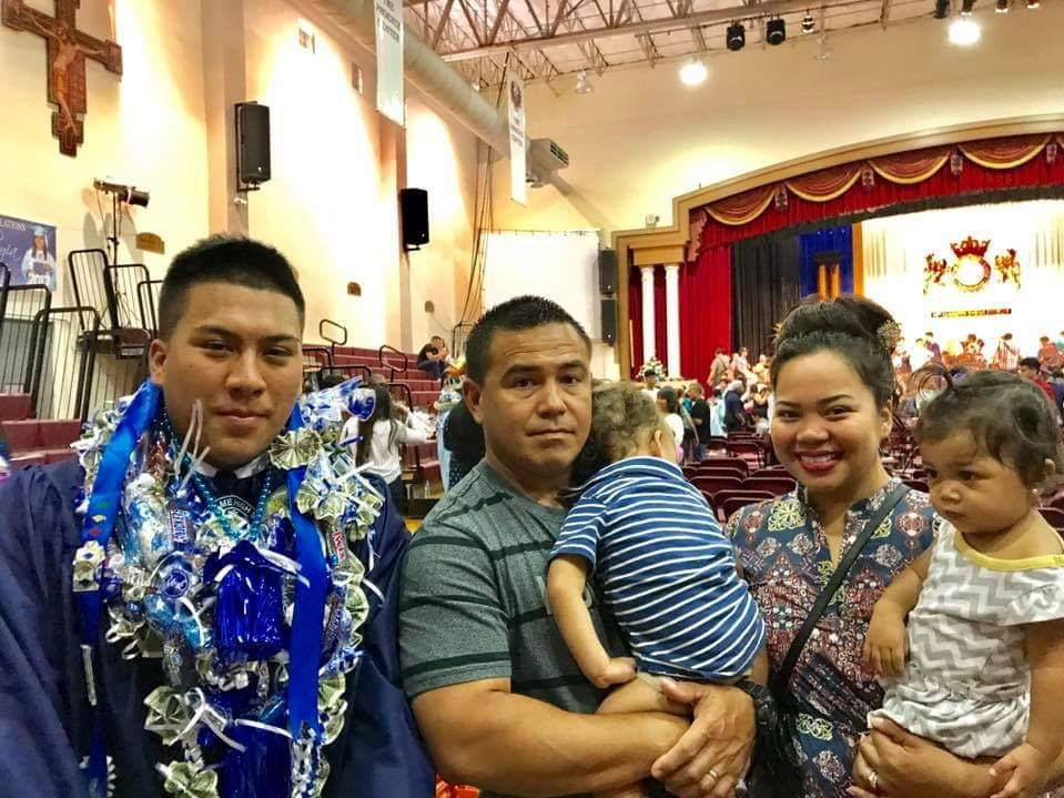 Deon Cruz, left, at his high school graduation.
