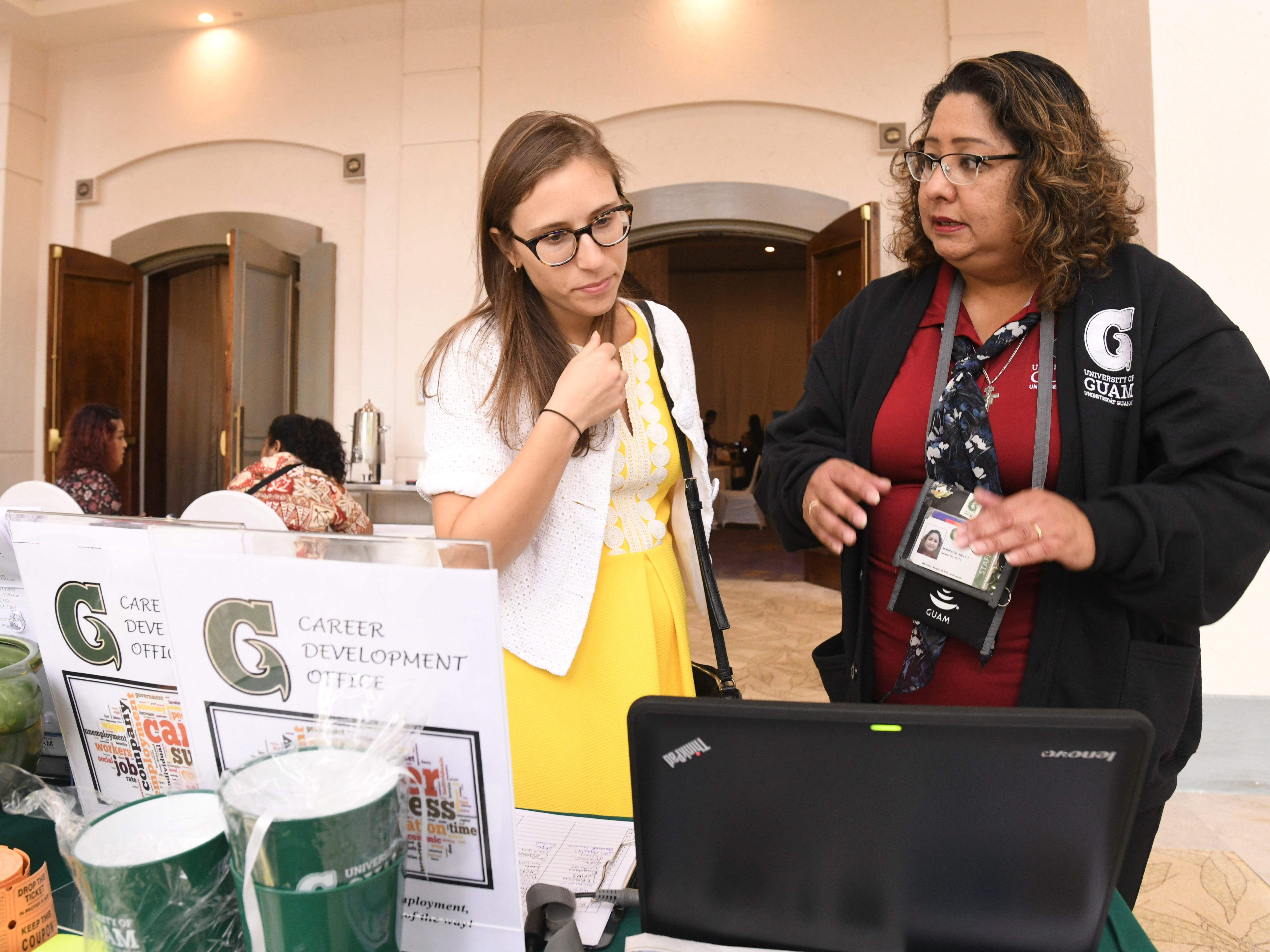 "Job seeker Rachel Stuart, left, listen to advice from University of Guam's Sallie McDonald during the Guam Chamber of Commerce's Women's Network 4th annual ""Propel Yourself"" job fair at the Hyatt Regency Guam in Tumon on Friday, Feb. 8, 2019."