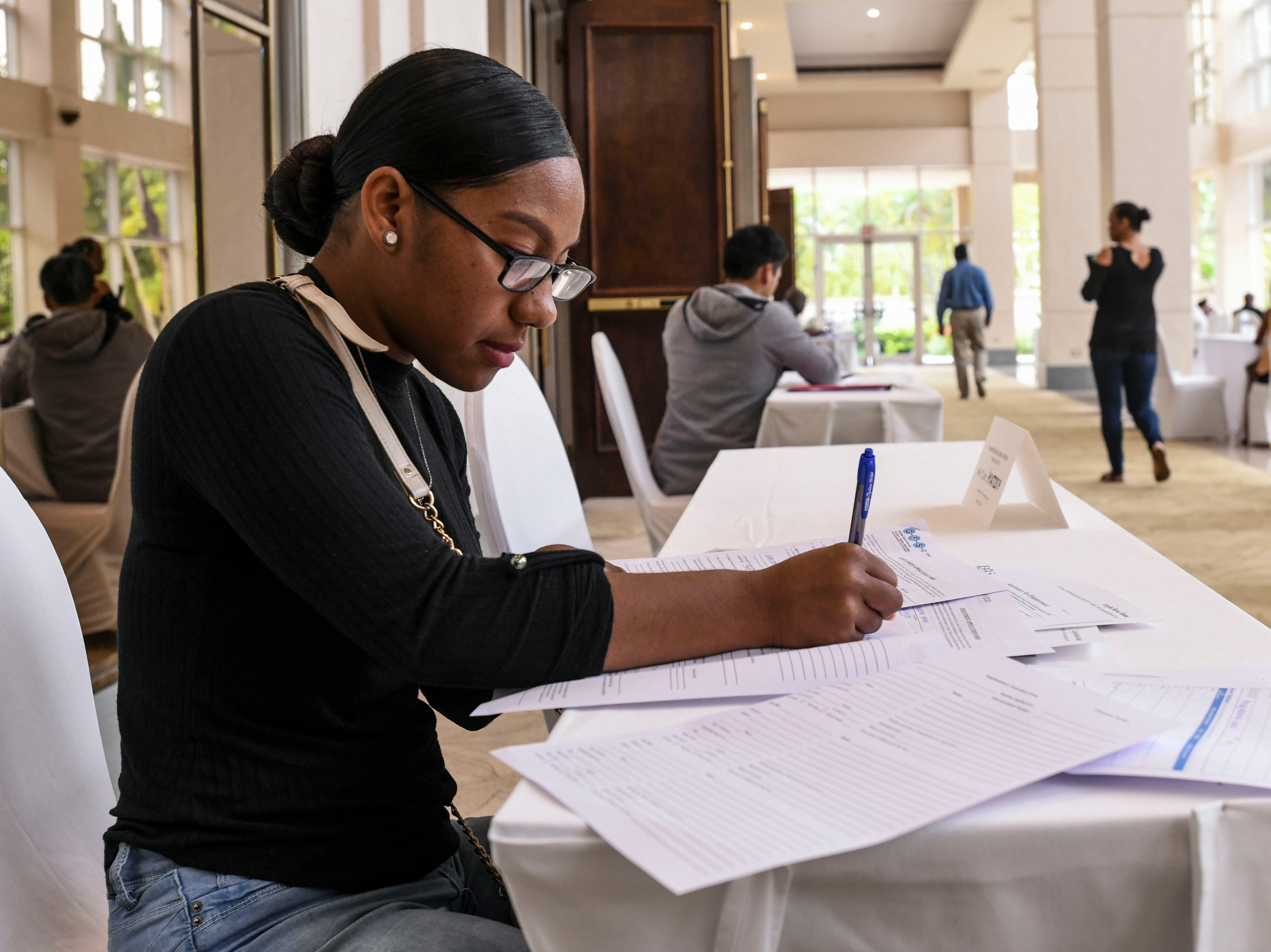 """Job seeker Layla Ham takes the time to fill out employment application, along with other applicants, during the Guam Chamber of Commerce's Women's Network 4th annual """"Propel Yourself"""" job fair at the Hyatt Regency Guam in Tumon on Friday, Feb. 8, 2019."""