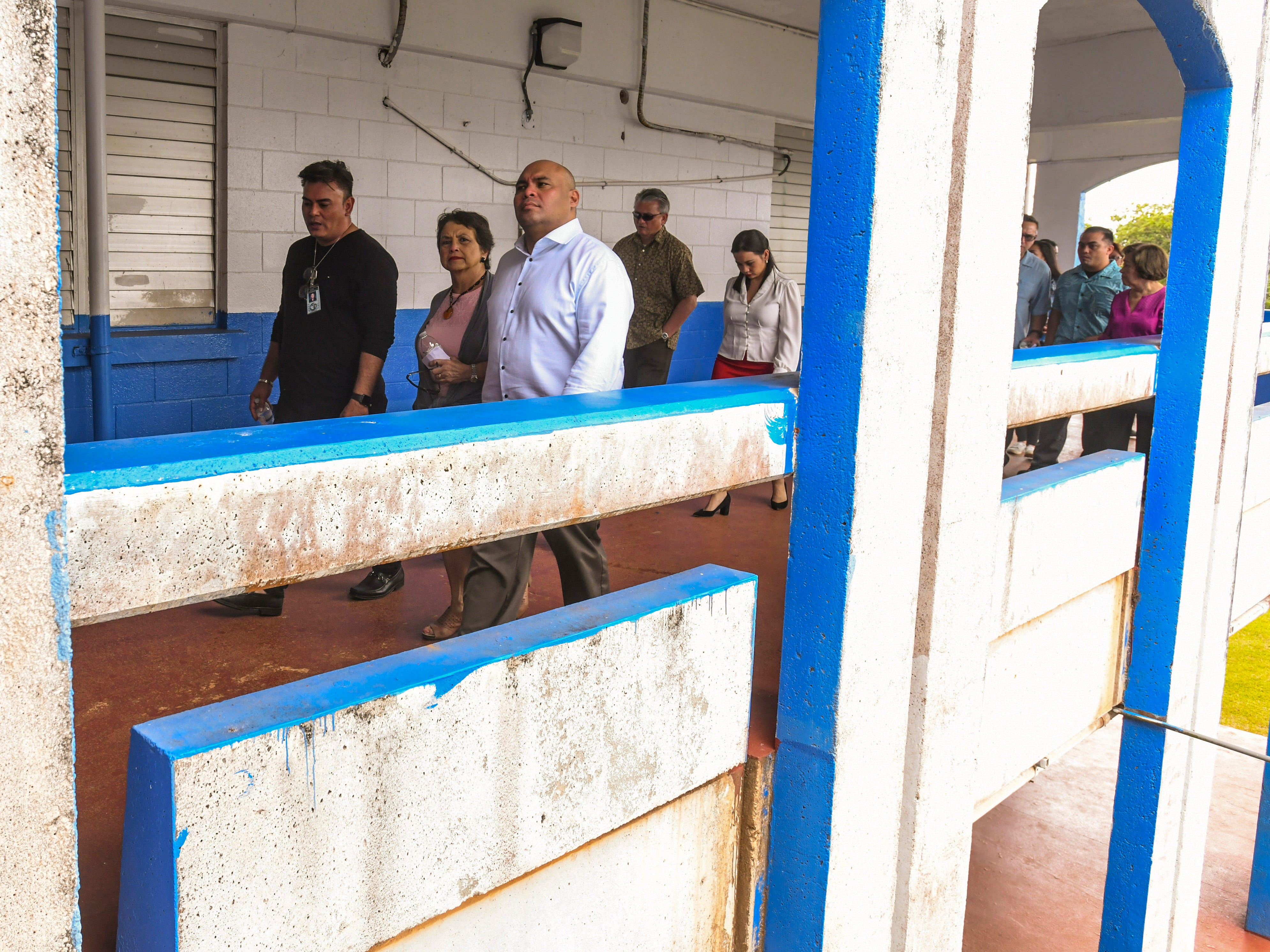 F.B. Leon Guerrero Middle School Principal Robert Martinez, right, escorts Gov. Lou Leon Guerrero, Lt. Gov. Josh Tenorio, education officials and others on a tour through the school campus in Yigo on Friday, Feb. 8, 2019.