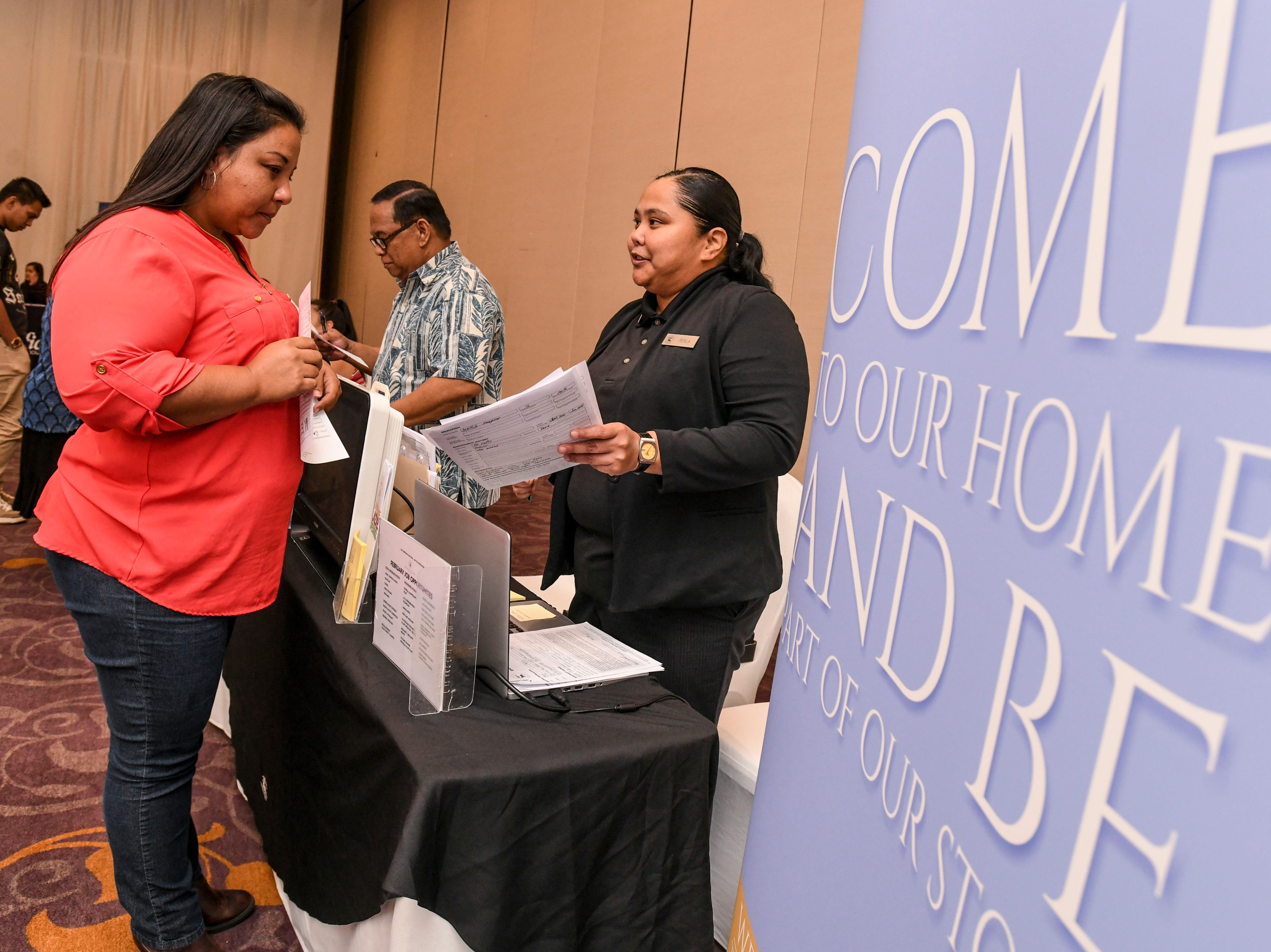 """Perla Mendiola, right, LeoPalace Resort Guam human resource employee, chats with a prospective applicant during the Guam Chamber of Commerce's Women's Network 4th annual """"Propel Yourself"""" job fair at the Hyatt Regency Guam in Tumon on Friday, Feb. 8, 2019."""