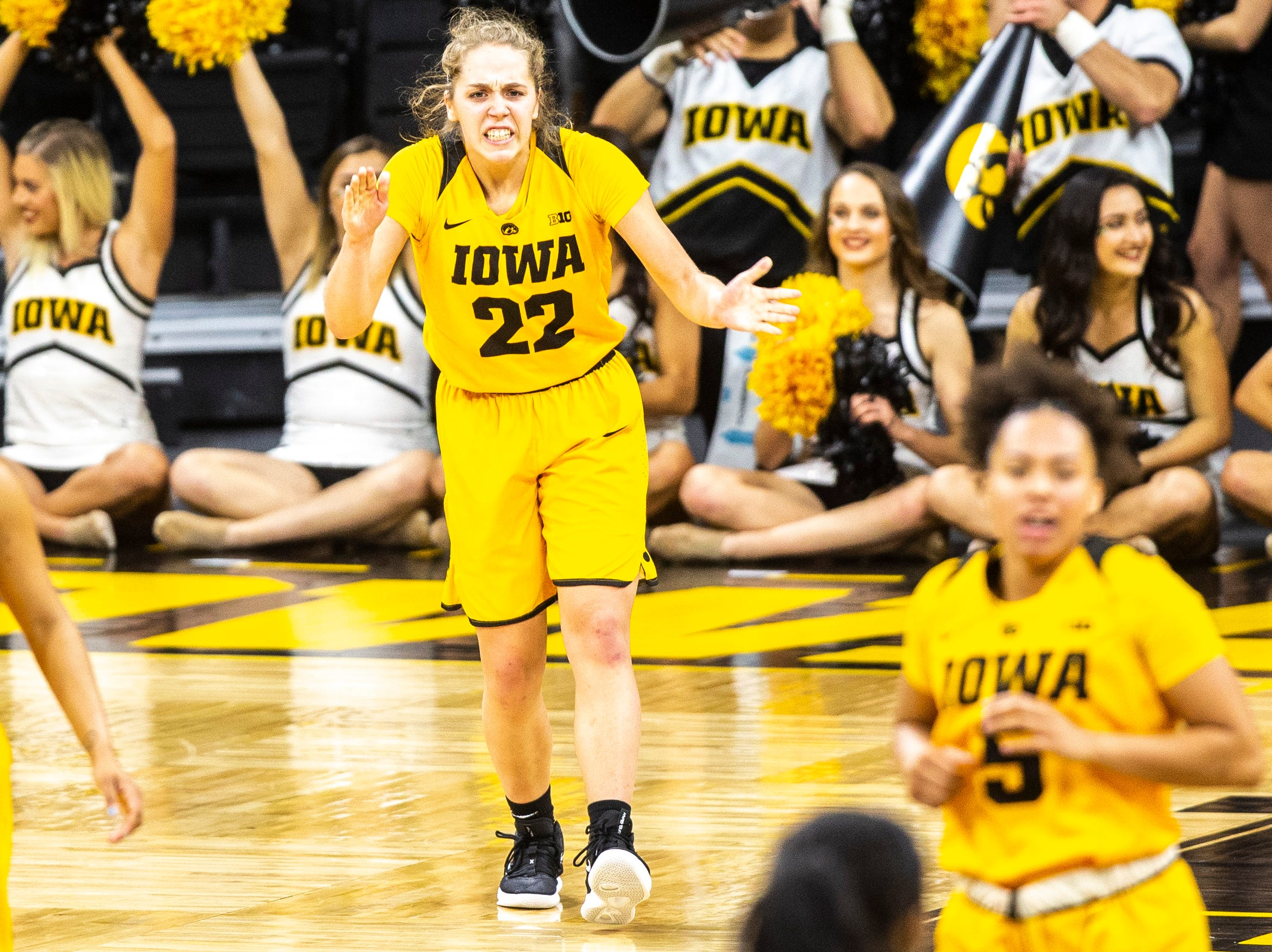 Iowa guard Kathleen Doyle (22) celebrates after making a shot during a NCAA Big Ten Conference women's basketball game on Thursday, Feb. 7, 2019 at Carver-Hawkeye Arena in Iowa City, Iowa.