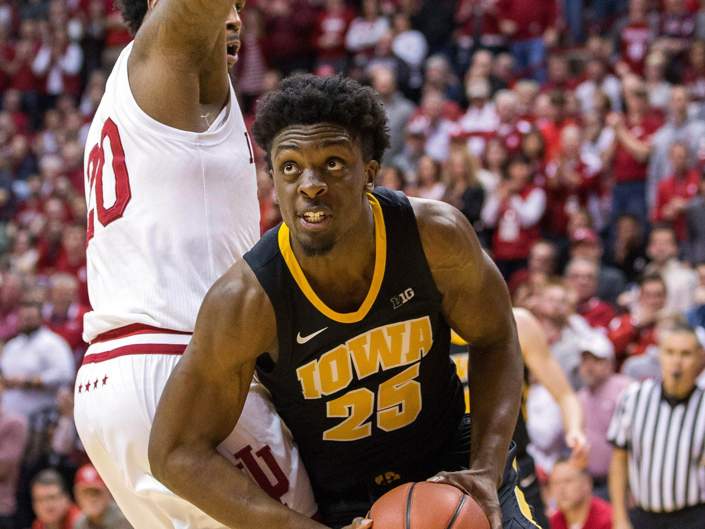 Iowa Hawkeyes forward Tyler Cook (25) looks to shoot the ball around Indiana Hoosiers forward De'Ron Davis (20) in the second half at Assembly Hall. Mandatory Credit: Trevor Ruszkowski-USA TODAY Sports