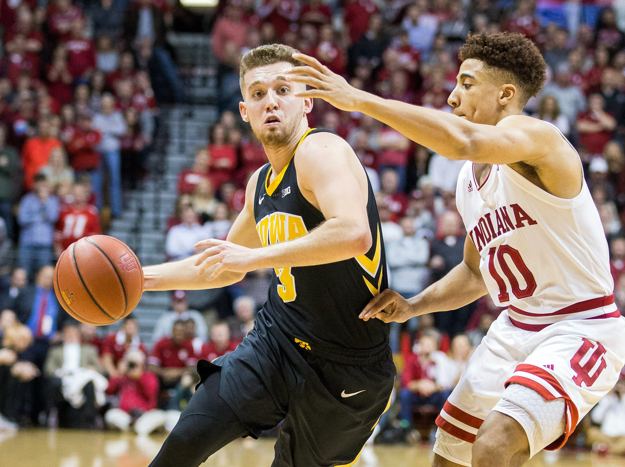Iowa Hawkeyes guard Jordan Bohannon (3) dribbles the ball while Indiana Hoosiers guard Rob Phinisee (10) defends in the second half at Assembly Hall. Mandatory Credit: Trevor Ruszkowski-USA TODAY Sports