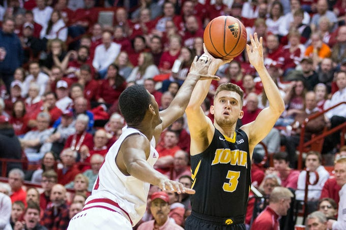 Iowa Hawkeyes guard Jordan Bohannon (3) shoots a three point basket while Indiana Hoosiers guard Aljami Durham (1) defends in the second half at Assembly Hall. Mandatory Credit: Trevor Ruszkowski-USA TODAY Sports