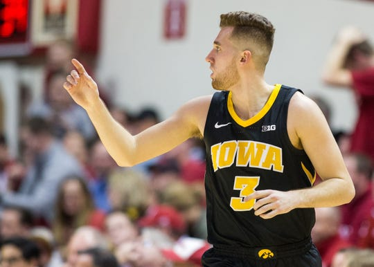 Iowa Hawkeyes guard Jordan Bohannon (3) celebrates a three point basket in the first half against the Indiana Hoosiers at Assembly Hall. Mandatory Credit: Trevor Ruszkowski-USA TODAY Sports