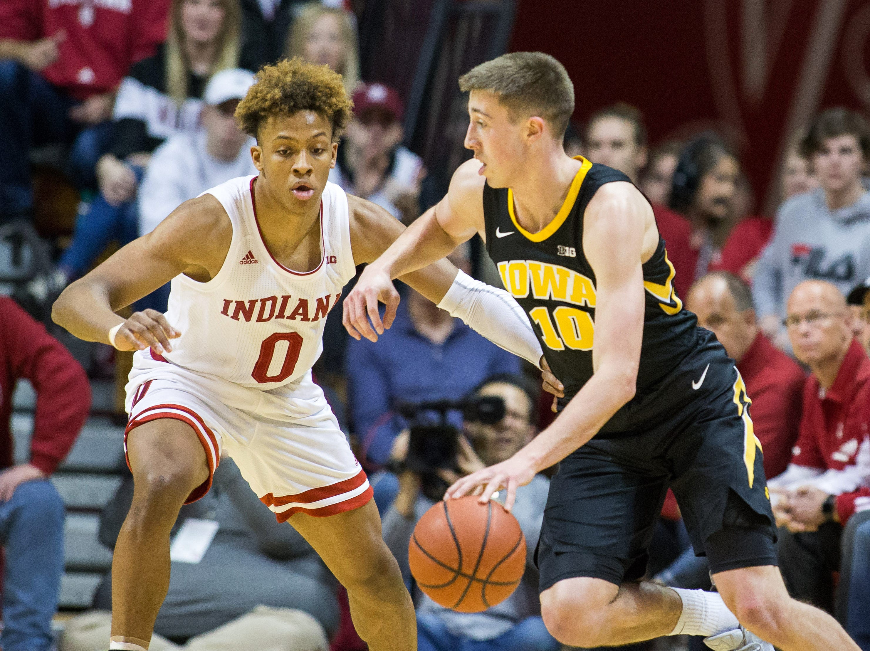 Iowa Hawkeyes guard Joe Wieskamp (10) dribbles the ball while Indiana Hoosiers guard Romeo Langford (0) defends in the first half on Thursday, Feb 7, 2019, at Assembly Hall in Bloomington, Indiana.