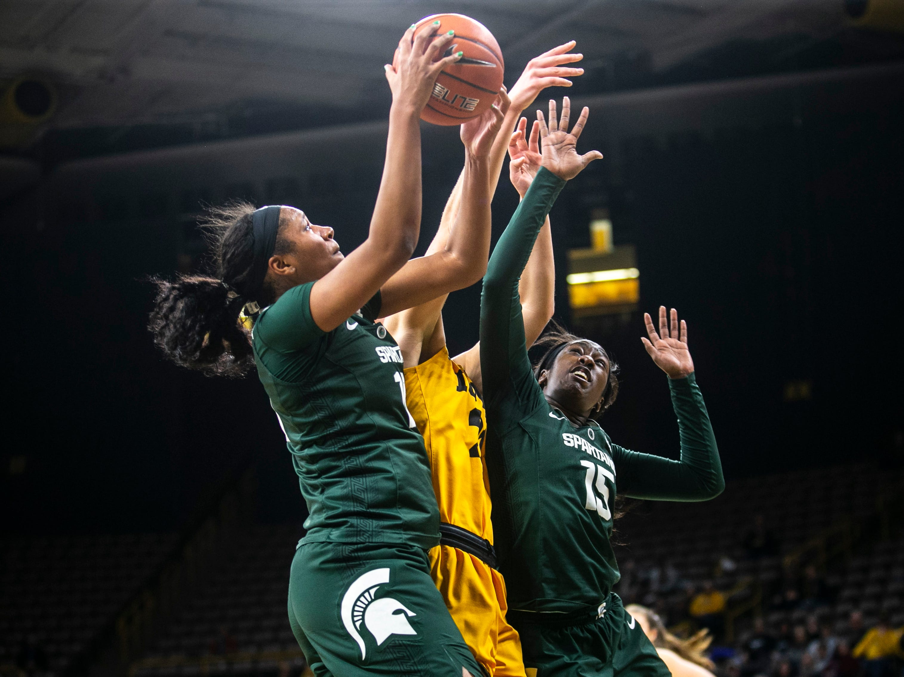 Michigan State forward Sidney Cooks (10) pulls down a rebound against Iowa's Monika Czinano (25) with Michigan State forward Victoria Gaines (15) during a NCAA Big Ten Conference women's basketball game on Thursday, Feb. 7, 2019 at Carver-Hawkeye Arena in Iowa City, Iowa.