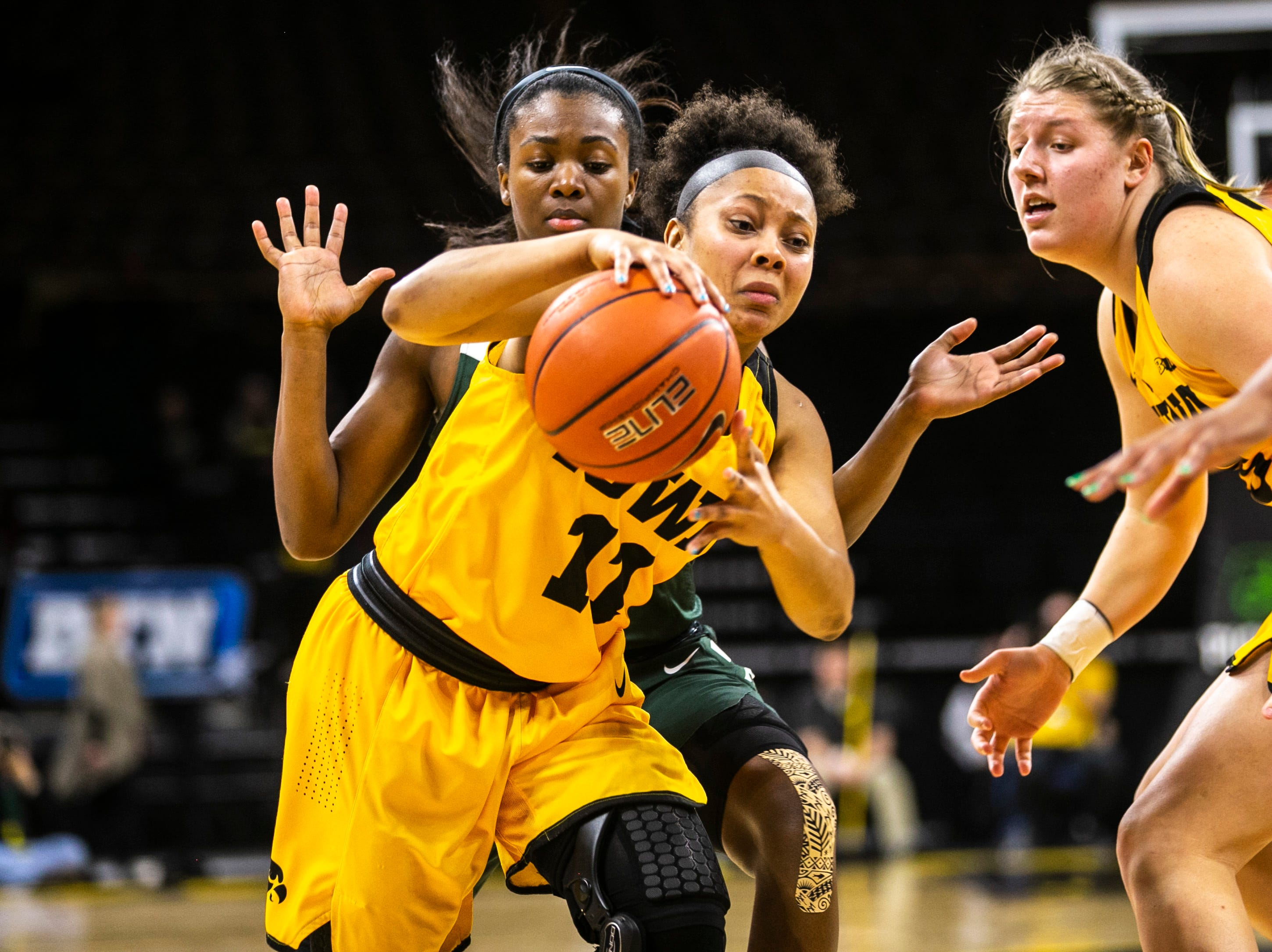 Iowa guard Tania Davis (11) drives to the hoop while Michigan State center Nia Clouden (24) defends during a NCAA Big Ten Conference women's basketball game on Thursday, Feb. 7, 2019 at Carver-Hawkeye Arena in Iowa City, Iowa.