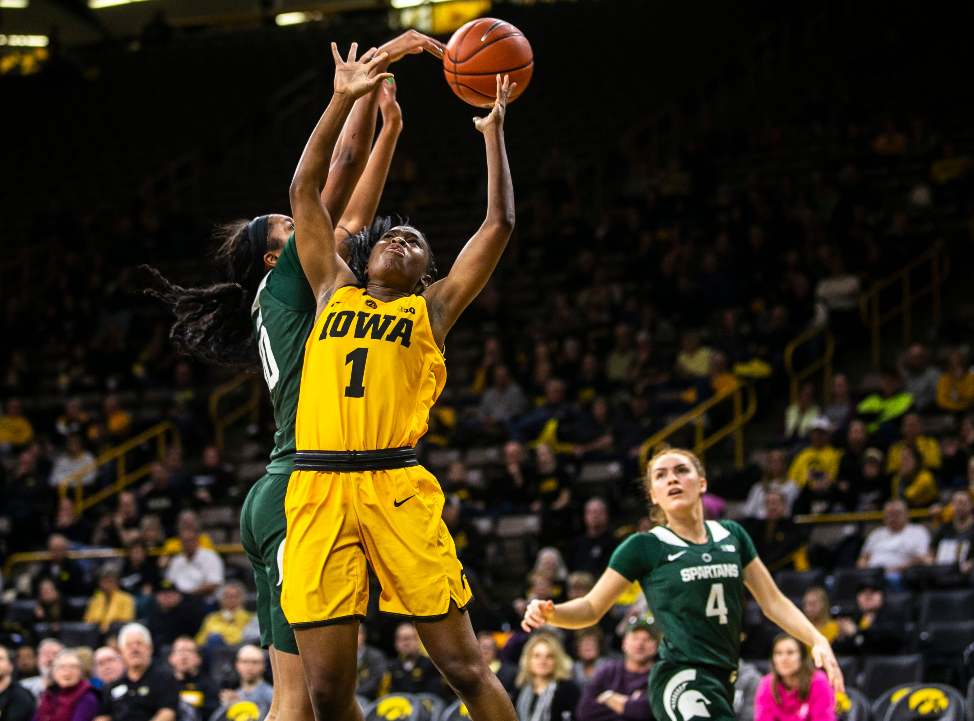 Michigan State forward Sidney Cooks (10) blocks Iowa guard Tomi Taiwo (1) during a NCAA Big Ten Conference women's basketball game on Thursday, Feb. 7, 2019 at Carver-Hawkeye Arena in Iowa City, Iowa.