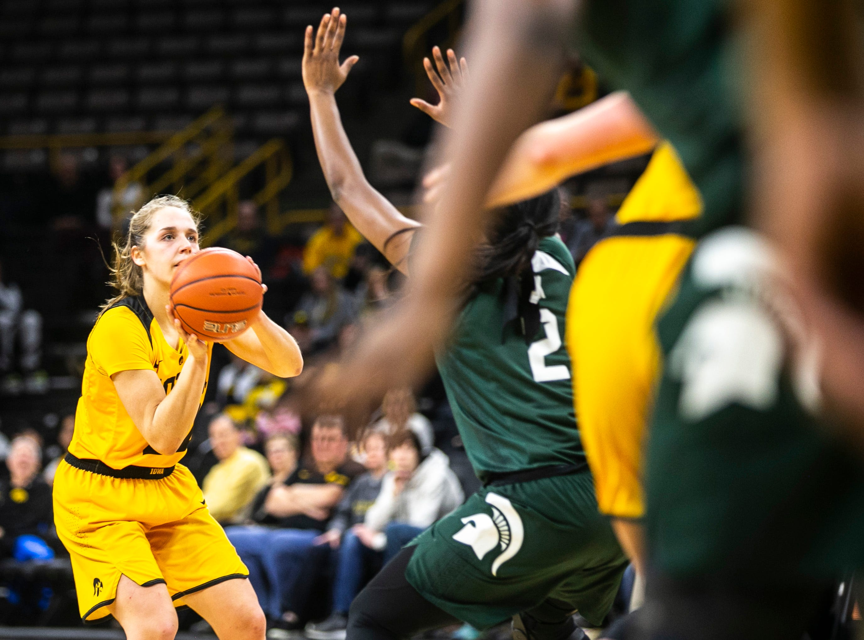 Iowa guard Kathleen Doyle (22) attempts a basket during a NCAA Big Ten Conference women's basketball game on Thursday, Feb. 7, 2019 at Carver-Hawkeye Arena in Iowa City, Iowa.