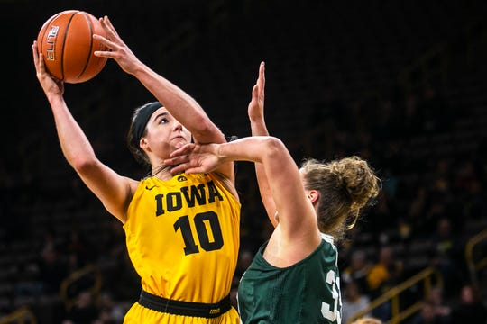 Iowa center Megan Gustafson (10) attempts a basket while Michigan State center Jenna Allen (33) defends during a NCAA Big Ten Conference women's basketball game on Thursday, Feb. 7, 2019 at Carver-Hawkeye Arena in Iowa City, Iowa.