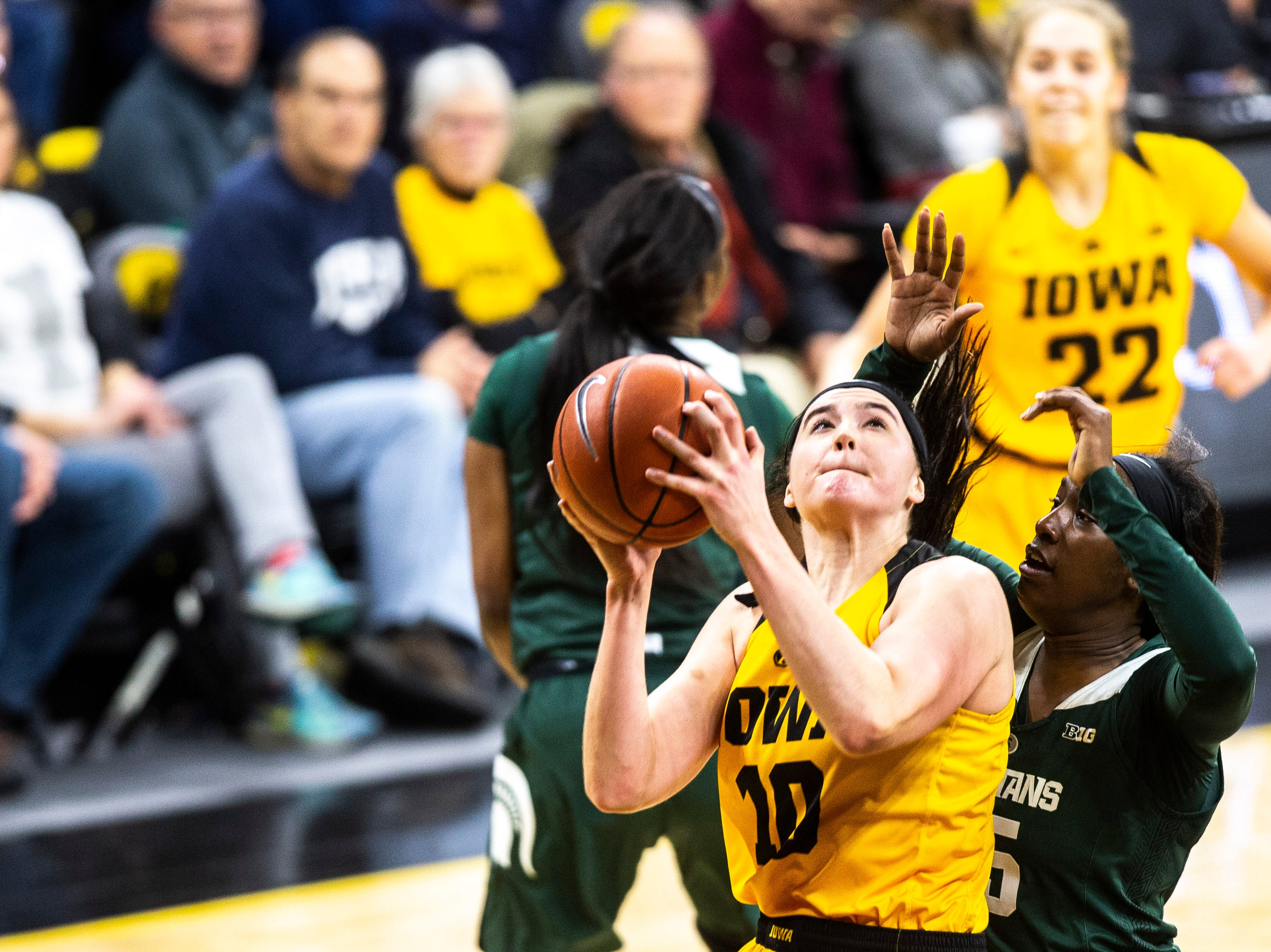 Iowa center Megan Gustafson (10) drives to the hoop while Michigan State forward Victoria Gaines (15) defends during a NCAA Big Ten Conference women's basketball game on Thursday, Feb. 7, 2019 at Carver-Hawkeye Arena in Iowa City, Iowa.