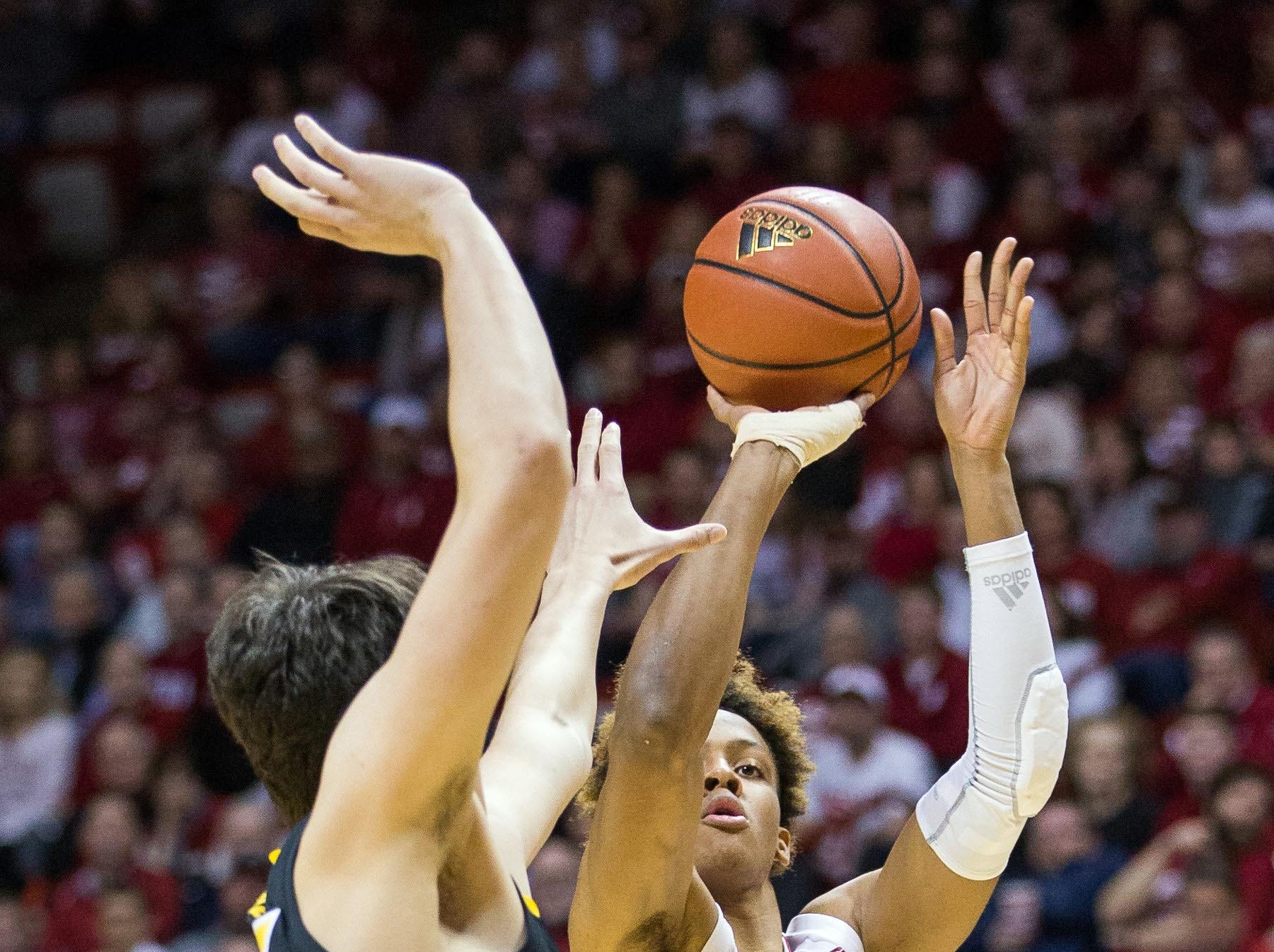 Indiana Hoosiers guard Romeo Langford (0) shoots the ball over Iowa Hawkeyes forward Luka Garza (55) in the first half at Assembly Hall. Mandatory Credit: Trevor Ruszkowski-USA TODAY Sports