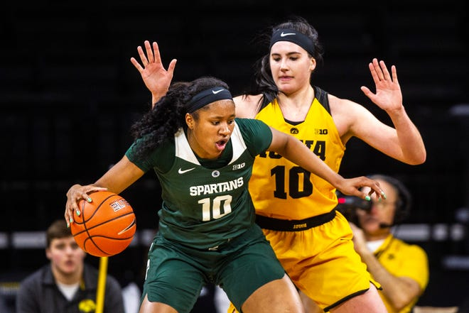Michigan State forward Sidney Cooks (10) gets defended by Iowa center Megan Gustafson, right, during a NCAA Big Ten Conference women's basketball game on Thursday, Feb. 7, 2019 at Carver-Hawkeye Arena in Iowa City, Iowa.