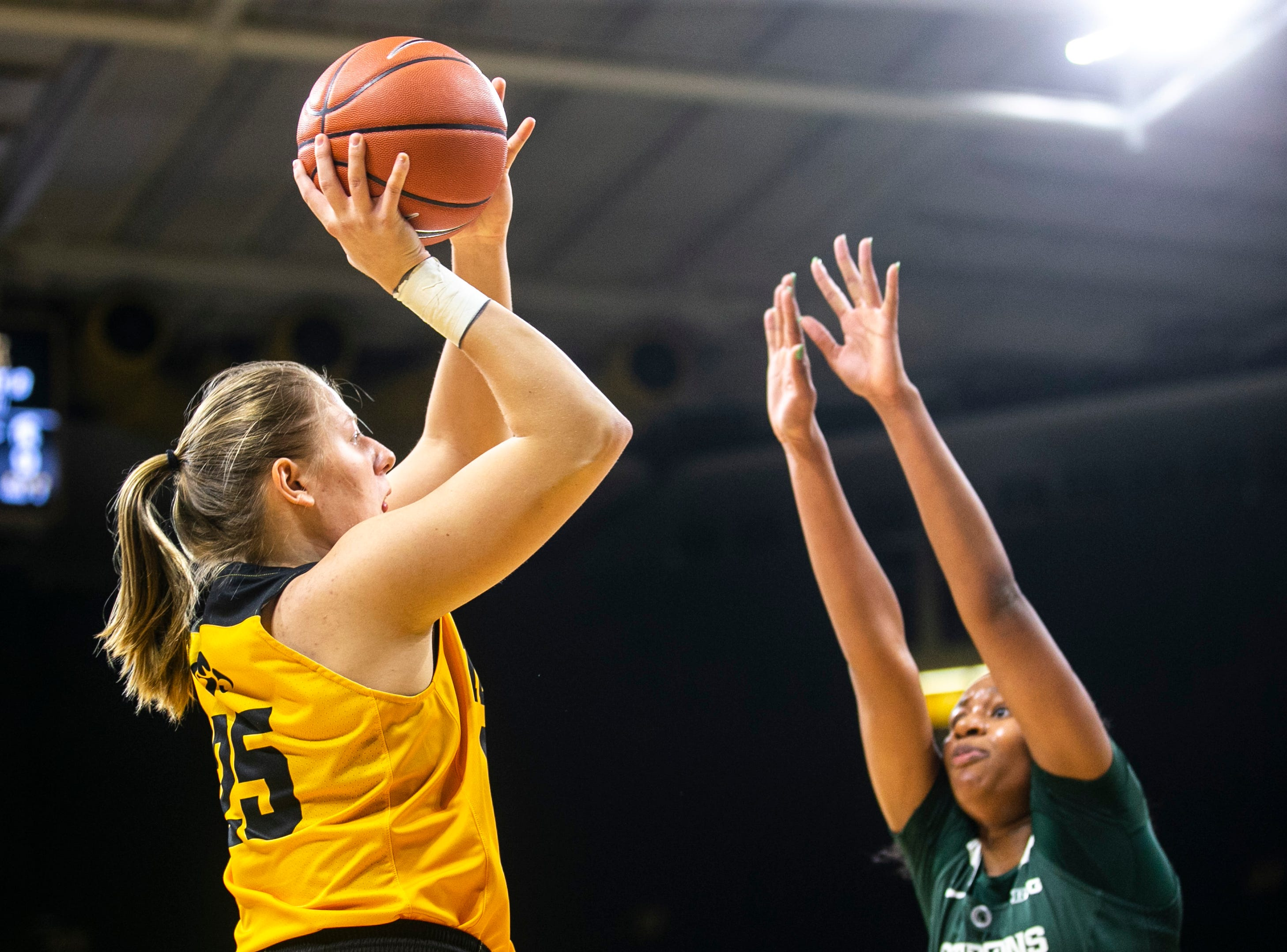Iowa's Monika Czinano (25) attempts a basket while Michigan State forward Sidney Cooks, right, defends during a NCAA Big Ten Conference women's basketball game on Thursday, Feb. 7, 2019 at Carver-Hawkeye Arena in Iowa City, Iowa.