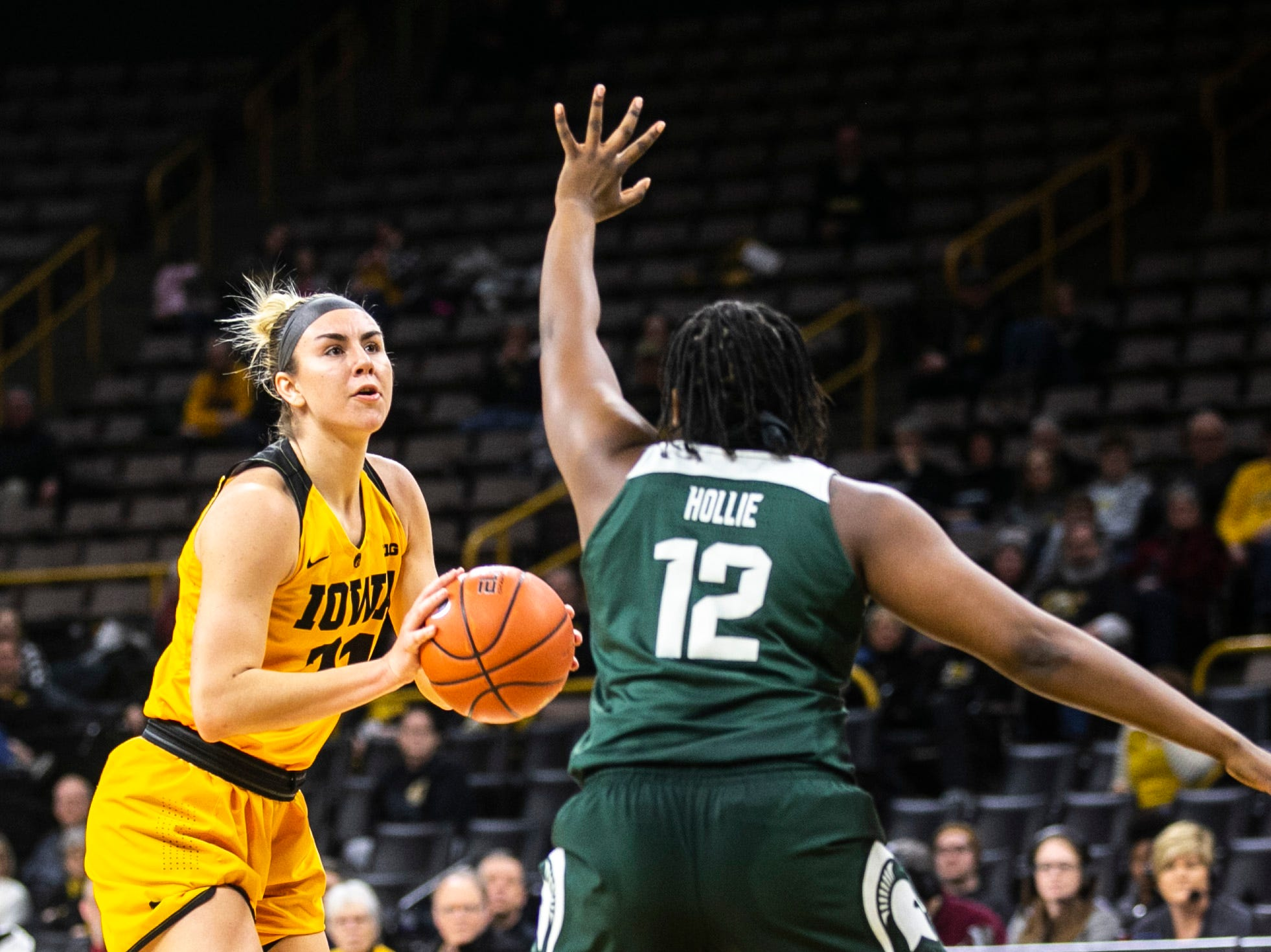 Iowa forward Hannah Stewart (21) attempts a basket while Michigan State forward Nia Hollie (12) defends during a NCAA Big Ten Conference women's basketball game on Thursday, Feb. 7, 2019 at Carver-Hawkeye Arena in Iowa City, Iowa.