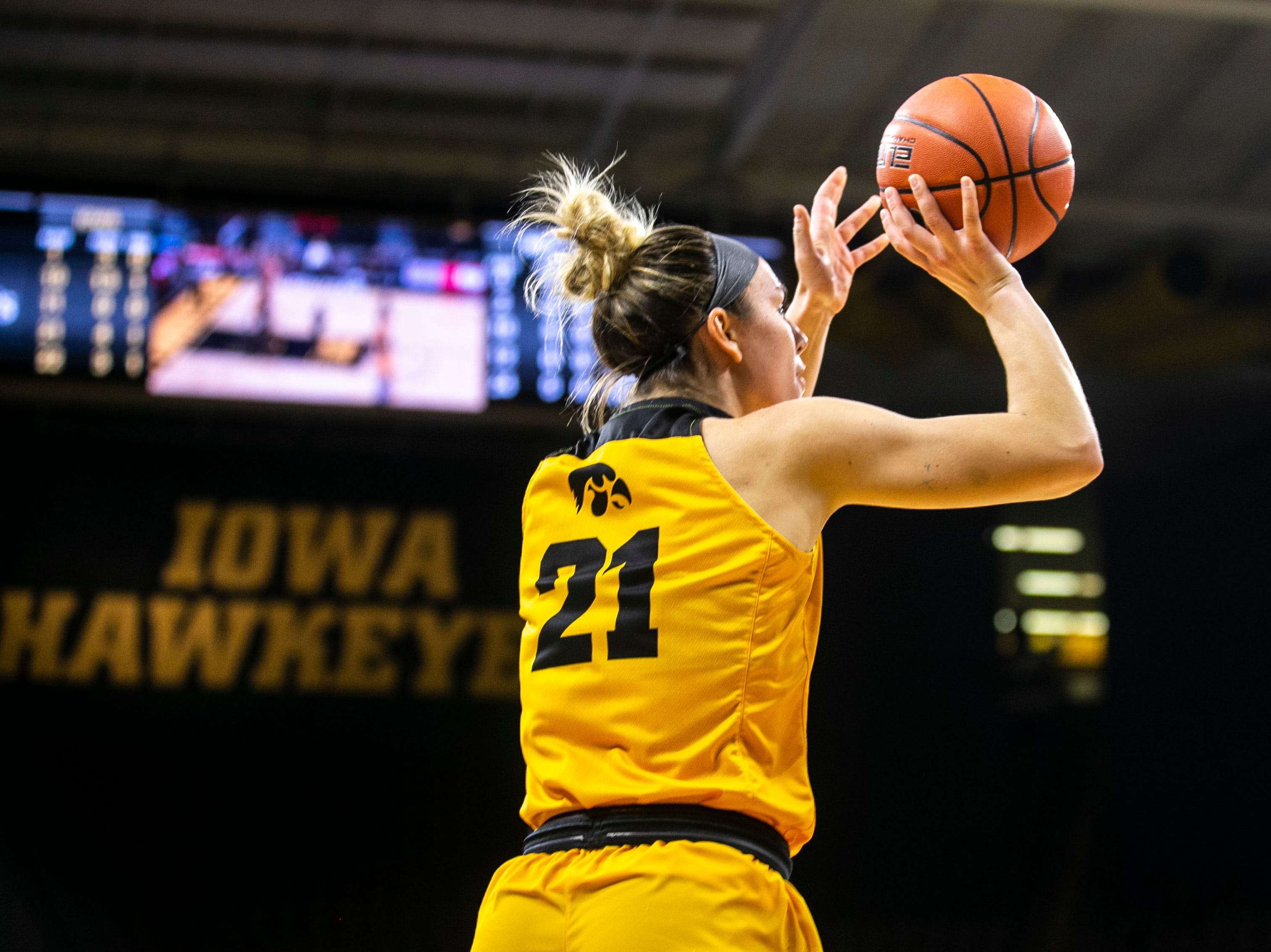 Iowa forward Hannah Stewart (21) attempts a basket during a NCAA Big Ten Conference women's basketball game on Thursday, Feb. 7, 2019 at Carver-Hawkeye Arena in Iowa City, Iowa.