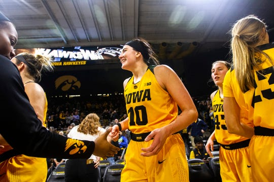 Iowa center Megan Gustafson (10) celebrates with teammates after a NCAA Big Ten Conference women's basketball game on Thursday, Feb. 7, 2019 at Carver-Hawkeye Arena in Iowa City, Iowa. The Hawkeyes defeated the Michigan State Spartans, 86-71.