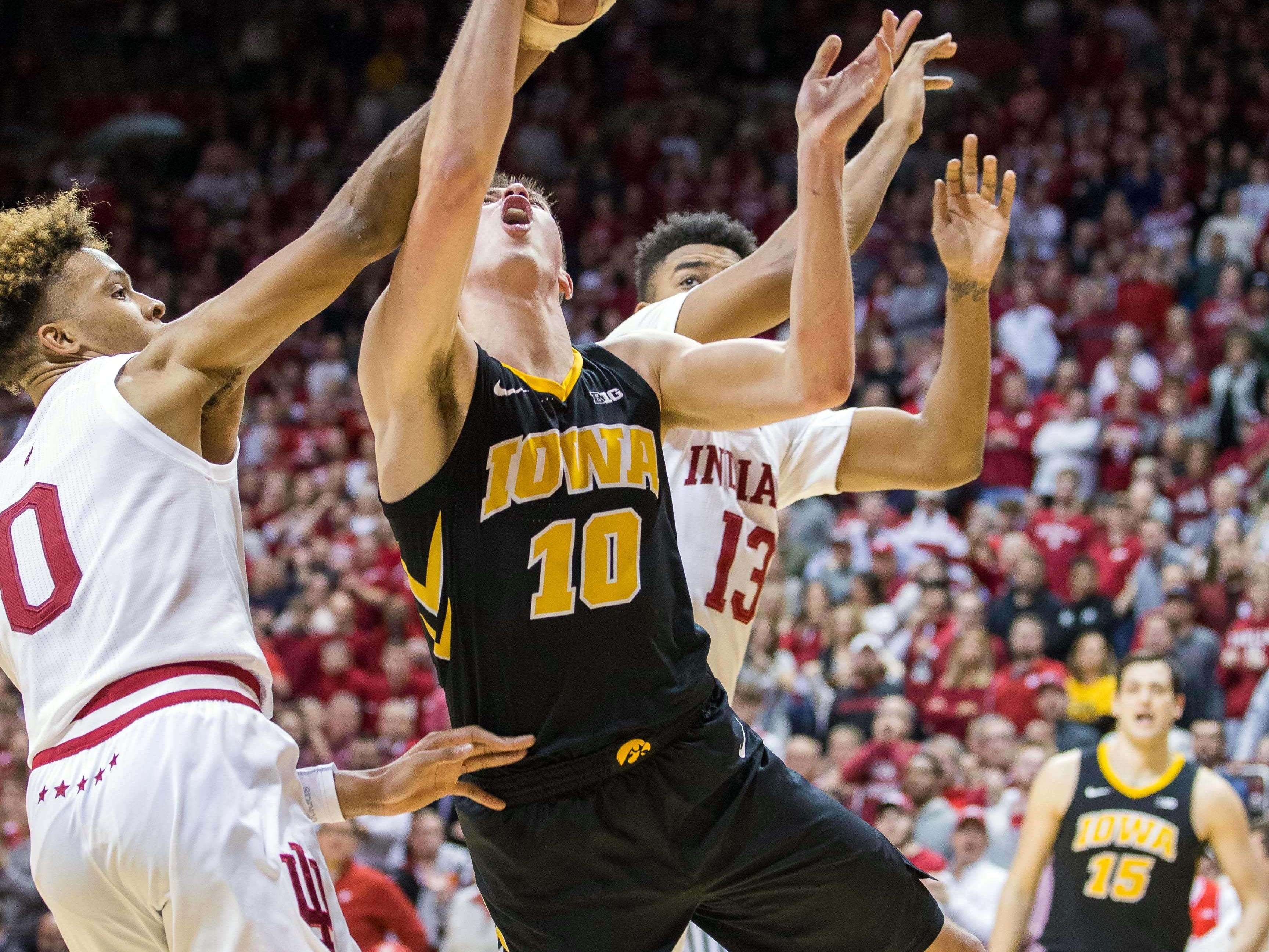 Indiana Hoosiers guard Romeo Langford (0) fouls Iowa Hawkeyes guard Joe Wieskamp (10) in the second half at Assembly Hall. Mandatory Credit: Trevor Ruszkowski-USA TODAY Sports