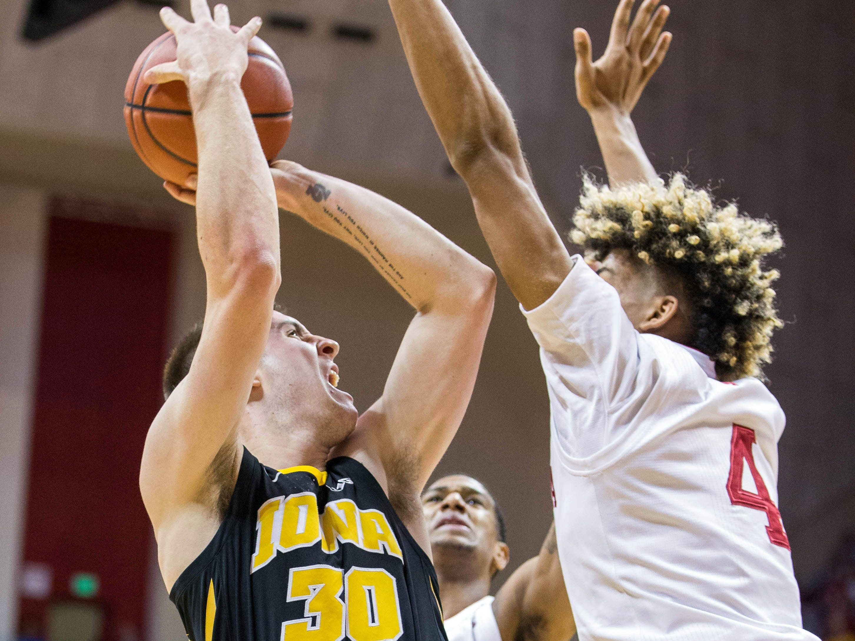 Iowa Hawkeyes guard Connor McCaffery (30) shoots the ball while Indiana Hoosiers forward Jake Forrester (4) defends in the second half at Assembly Hall. Mandatory Credit: Trevor Ruszkowski-USA TODAY Sports