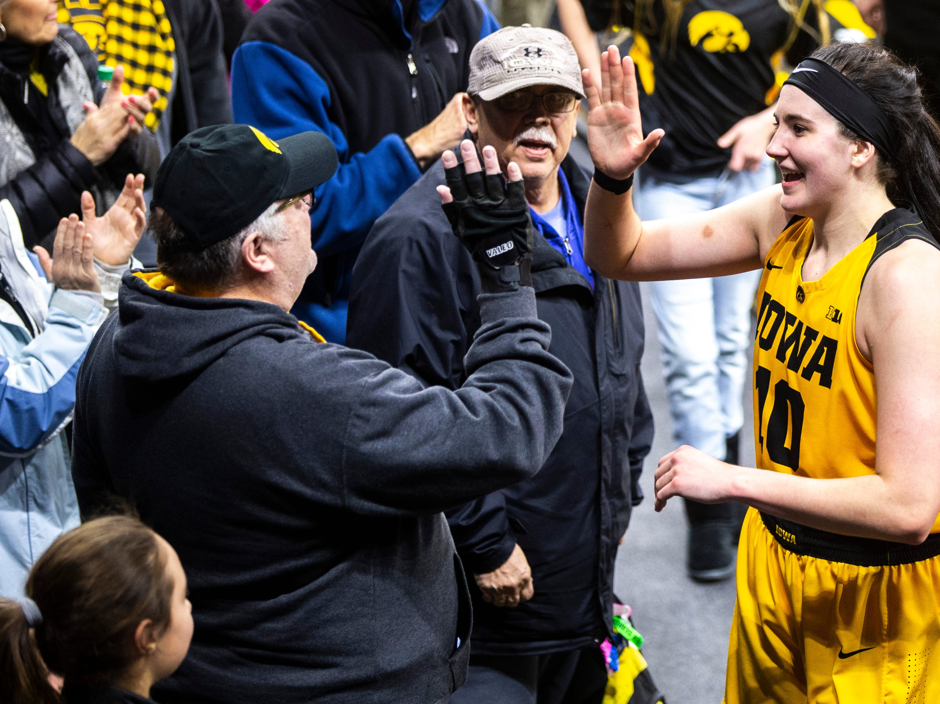 Iowa center Megan Gustafson (10) high-fives fans after a NCAA Big Ten Conference women's basketball game on Thursday, Feb. 7, 2019 at Carver-Hawkeye Arena in Iowa City, Iowa.
