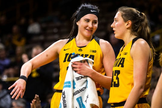 Iowa center Megan Gustafson (10) talks with Iowa forward Amanda Ollinger (43) during a NCAA Big Ten Conference women's basketball game on Thursday, Feb. 7, 2019 at Carver-Hawkeye Arena in Iowa City, Iowa.