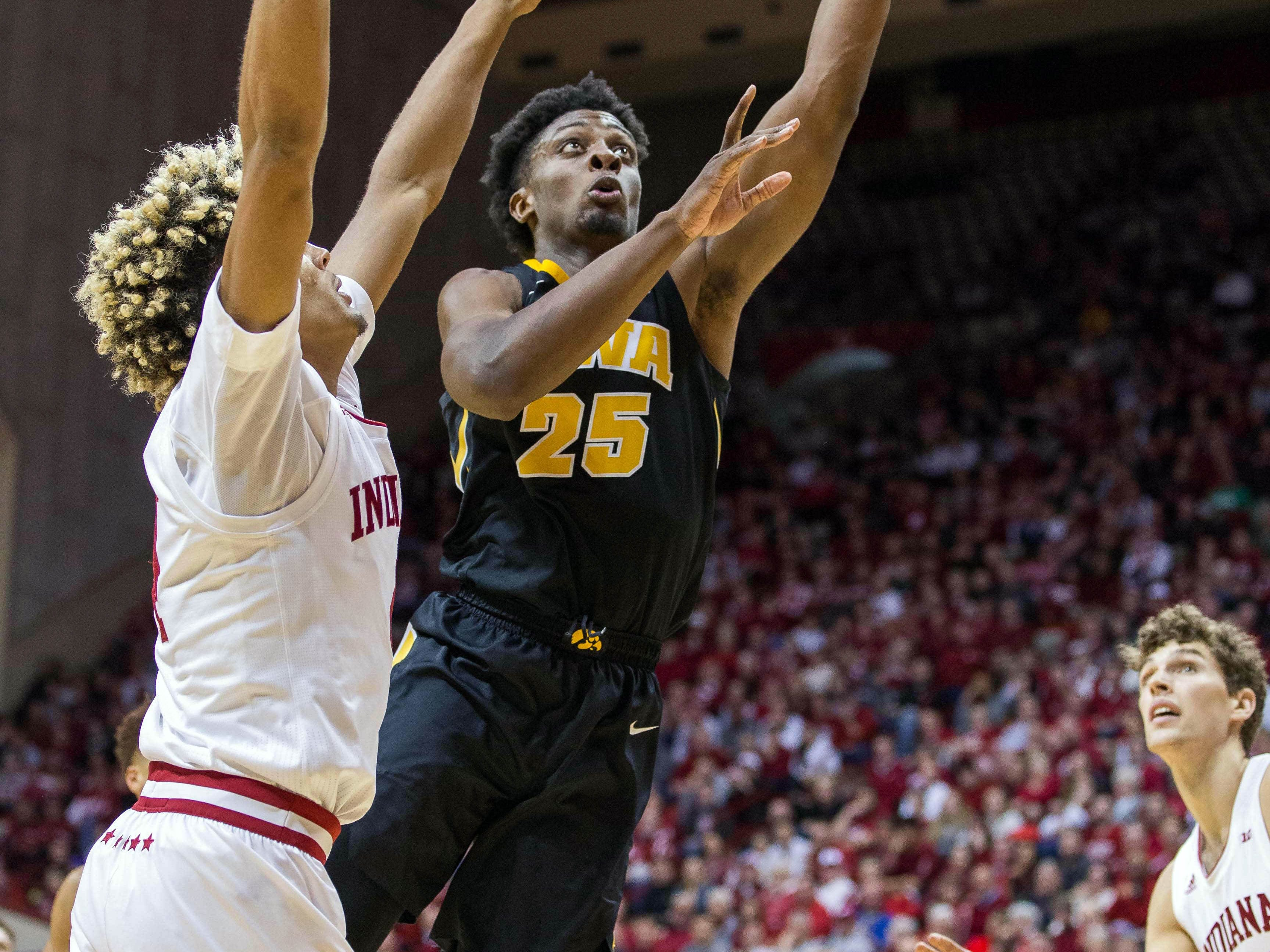 Iowa Hawkeyes forward Tyler Cook (25) shoots the ball over Indiana Hoosiers forward Jake Forrester (4) in the second half at Assembly Hall. Mandatory Credit: Trevor Ruszkowski-USA TODAY Sports