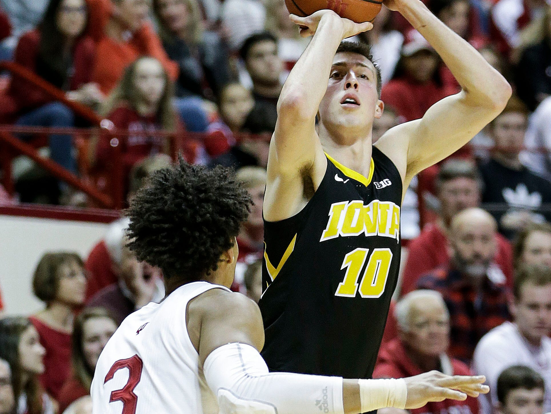 Iowa forward Joe Wieskamp rises up for one of his four first-half 3-pointers Thursday, this one over Indiana's Justin Smith.