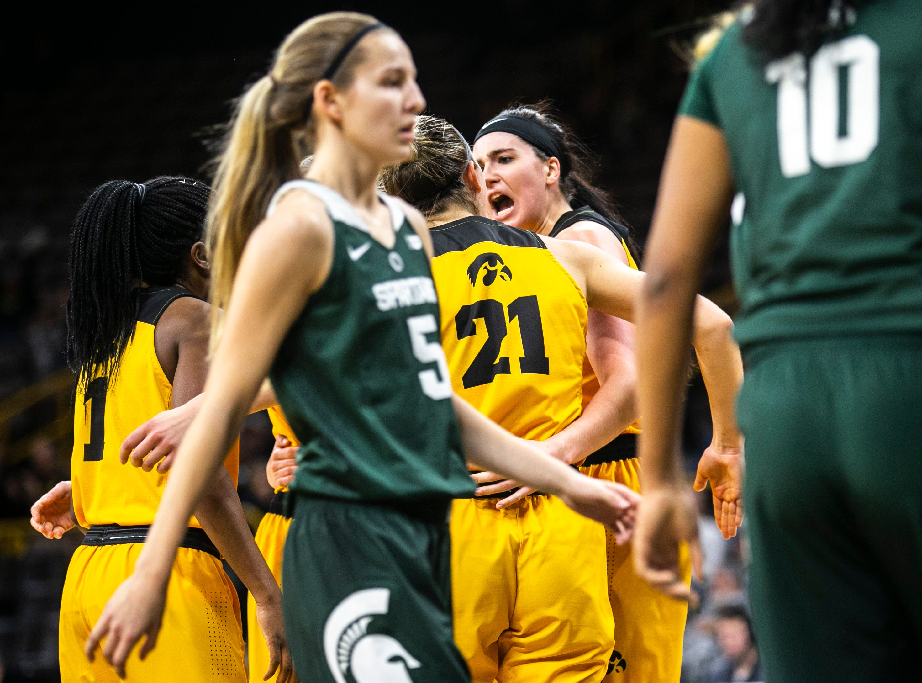 Iowa center Megan Gustafson celebrates with teammates after drawing a foul during a NCAA Big Ten Conference women's basketball game on Thursday, Feb. 7, 2019 at Carver-Hawkeye Arena in Iowa City, Iowa.