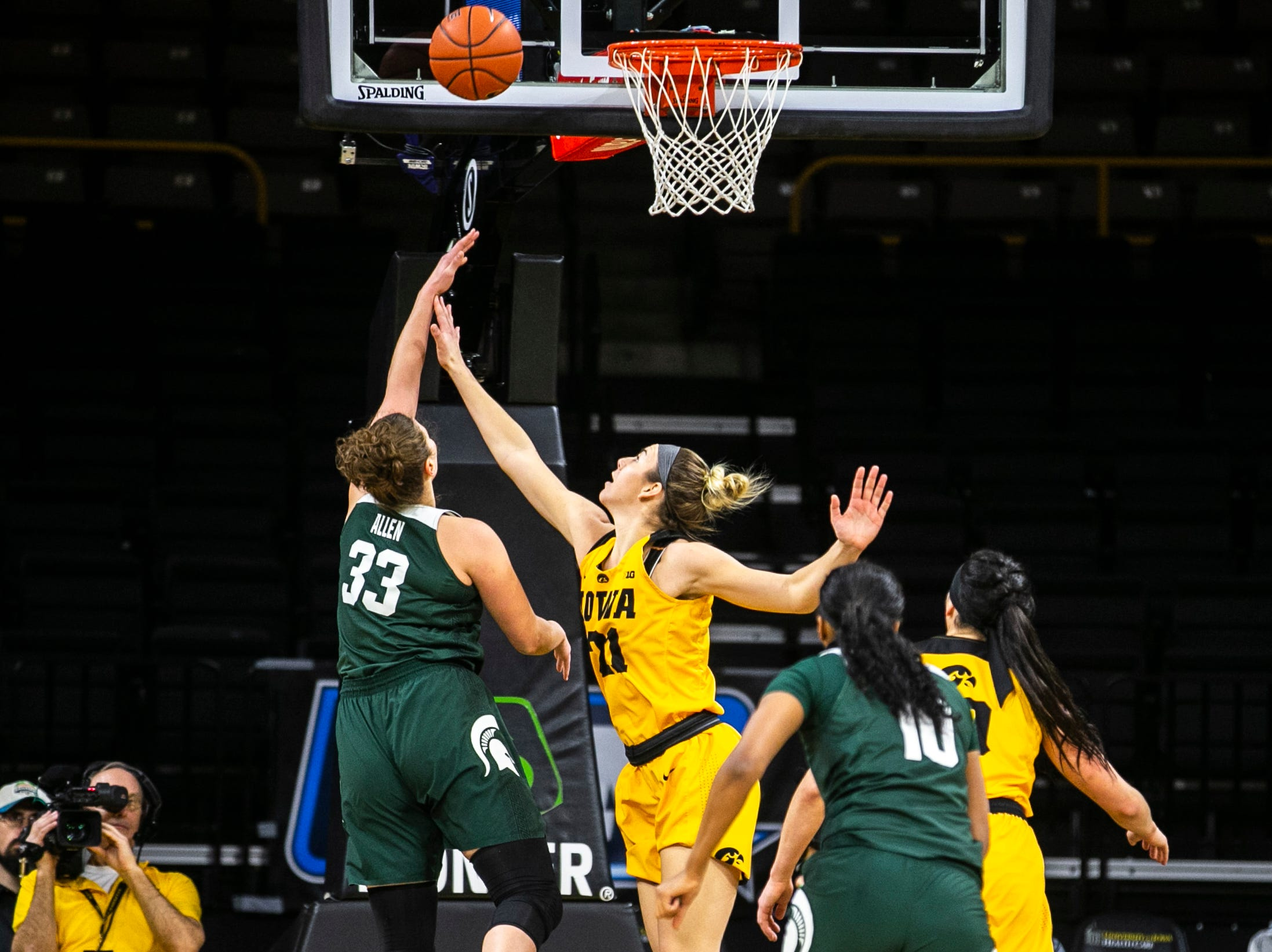 Iowa forward Hannah Stewart (21) defends Michigan State center Jenna Allen (33) during a NCAA Big Ten Conference women's basketball game on Thursday, Feb. 7, 2019 at Carver-Hawkeye Arena in Iowa City, Iowa.