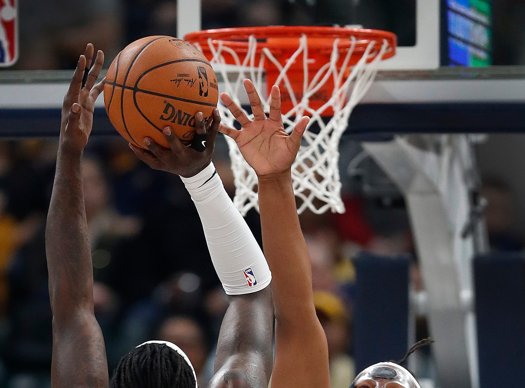 Indiana Pacers center Myles Turner (33) attempts to block the shot by LA Clippers forward Montrezl Harrell (5) in the first half of their game at Bankers Life Fieldhouse on Thursday, Feb. 7, 2019.