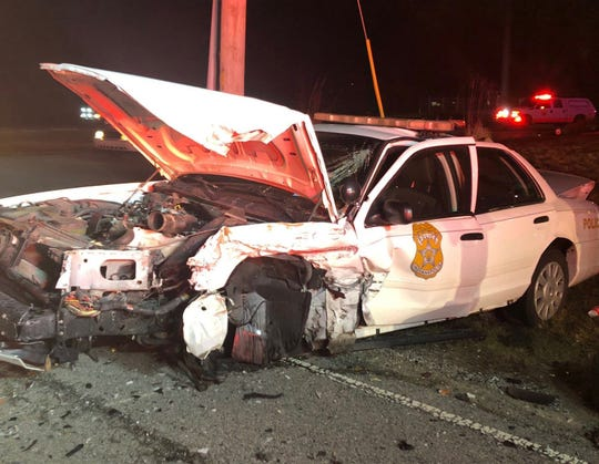 An IMPD officer suffered minor injuries in a head-on crash with a suspected drunken driver Thursday night.