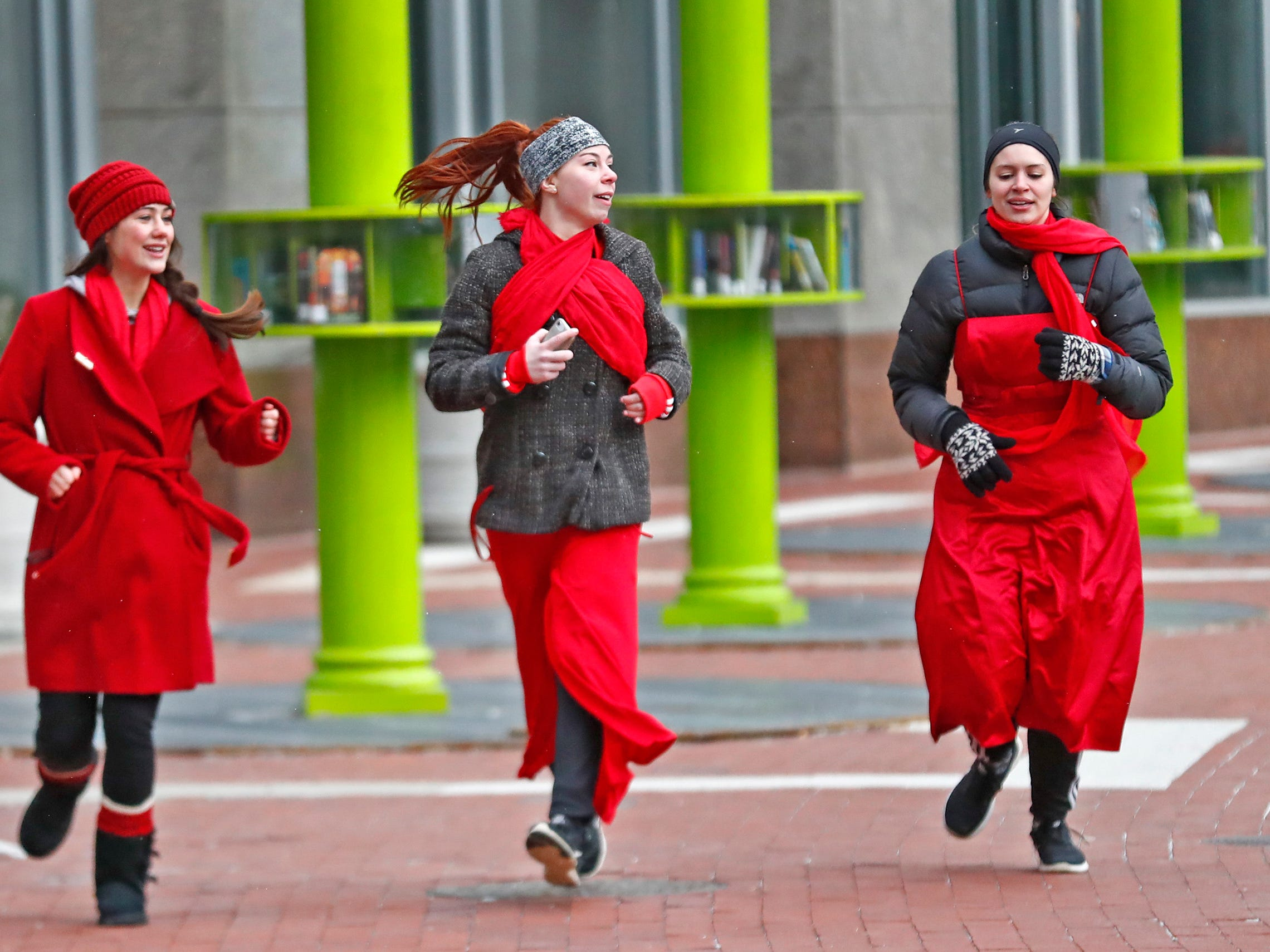 Sydni Yates, from left, Melissa Yannetti, and Caitie Harmon wear red as they dash around Monument Circle for the Red Dress Dash, Friday, Feb. 8, 2019.  The American Heart Association put on the seventh annual event to support women's heart health.  The event raises awareness for the American Heart Association's Go Red For Women movement.  Heart disease is the leading cause of death among women.