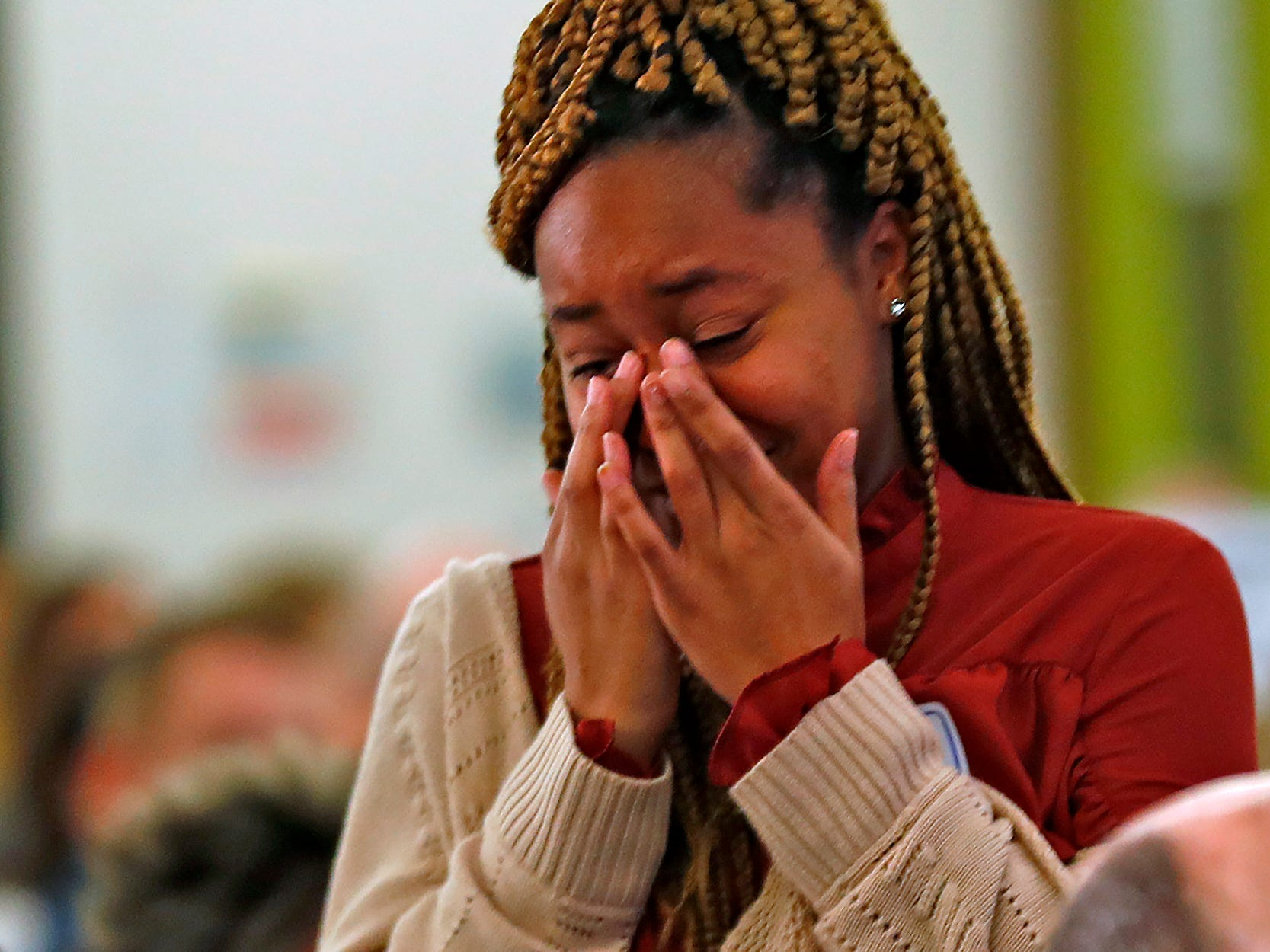 Pike High School student Danielle Jackson wipes away tears of joy as she walks up to receive her 2nd Place Scholarship award at the 44th Annual Abe Lincoln Awards Program, Friday, Feb. 8, 2019. The Kiwanis Club of Indianapolis program was held at Ivy Tech Community College.  20 high school student were honored at the annual event which celebrates overcoming adversity in life to succeed. Four of the 20 students received scholarships.
