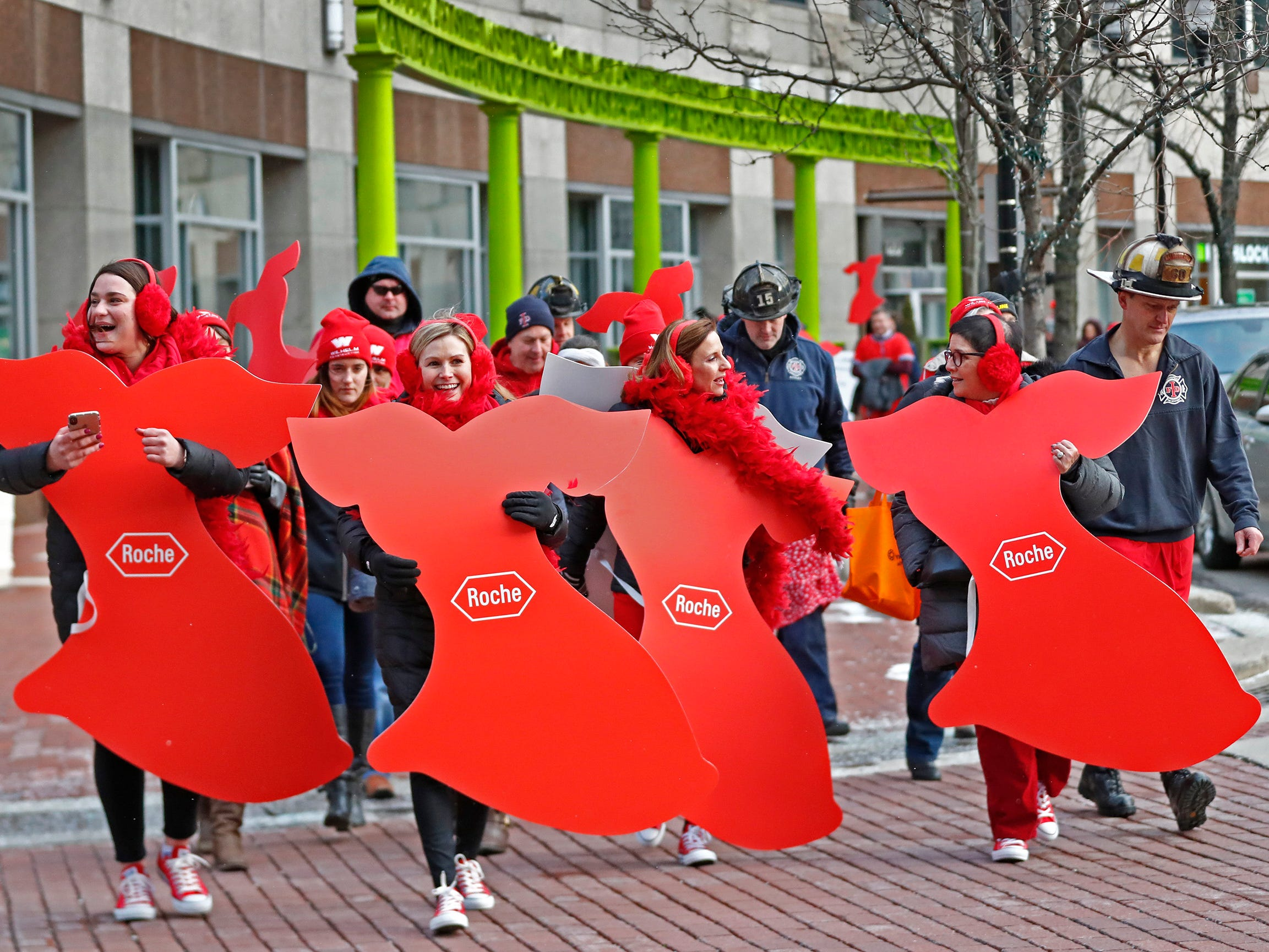 People wear red as they walk around Monument Circle for the Red Dress Dash, Friday, Feb. 8, 2019.  The American Heart Association put on the seventh annual event to support women's heart health.  The event raises awareness for the American Heart Association's Go Red For Women movement.  Heart disease is the leading cause of death among women.
