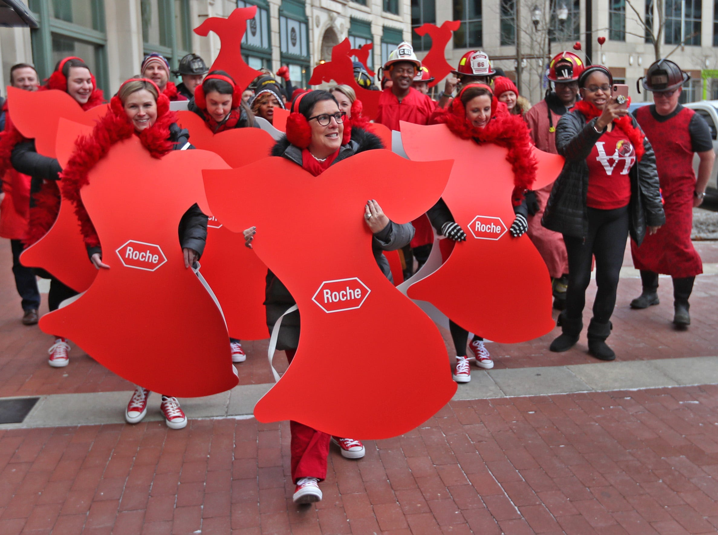 A sea of red, led by Roche employees in red cutout dresses, start the dash around Monument Circle for the Red Dress Dash, Friday, Feb. 8, 2019.  Go Red for Women 2019 Chair Jennifer Zinn, center, leads the way.  The American Heart Association put on the seventh annual event to support women's heart health.  The event raises awareness for the American Heart Association's Go Red For Women movement.  Heart disease is the leading cause of death among women.